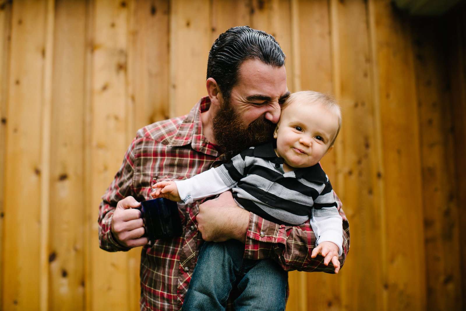 Youngstown OH bearded dad holding son and cup of coffee