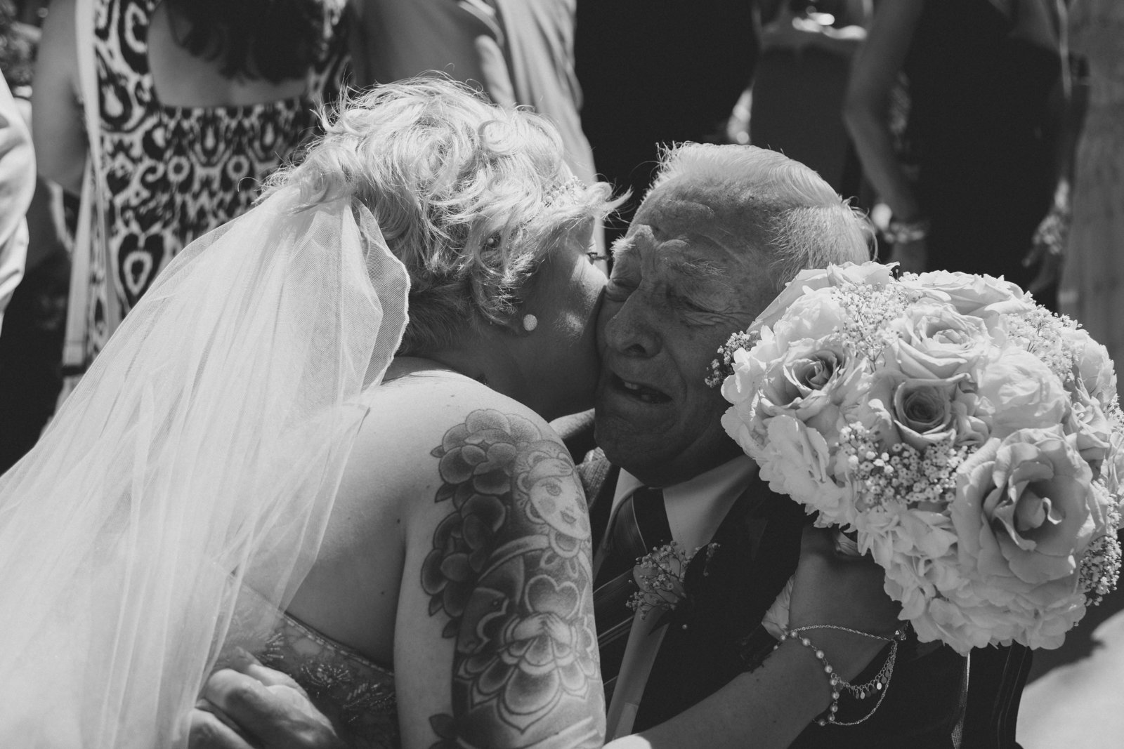 Bride kisses grandpa