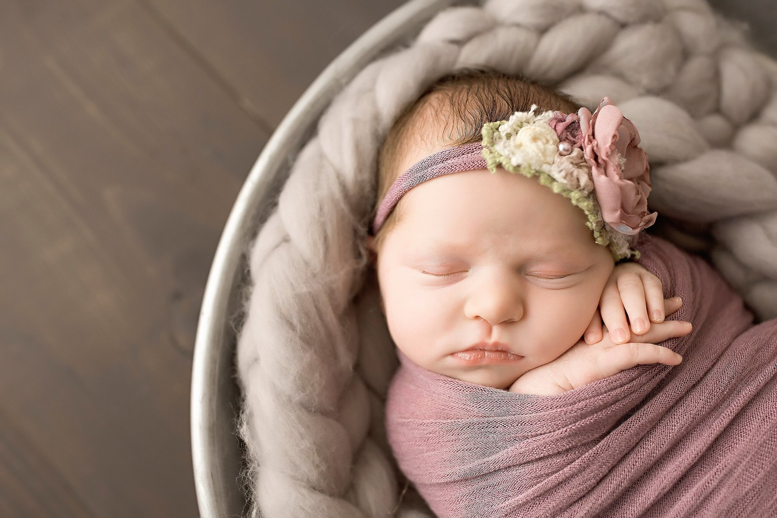 Newborn girl in mauve