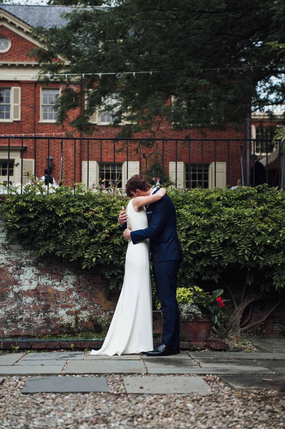 bride and groom hug after seeing each other for the first time