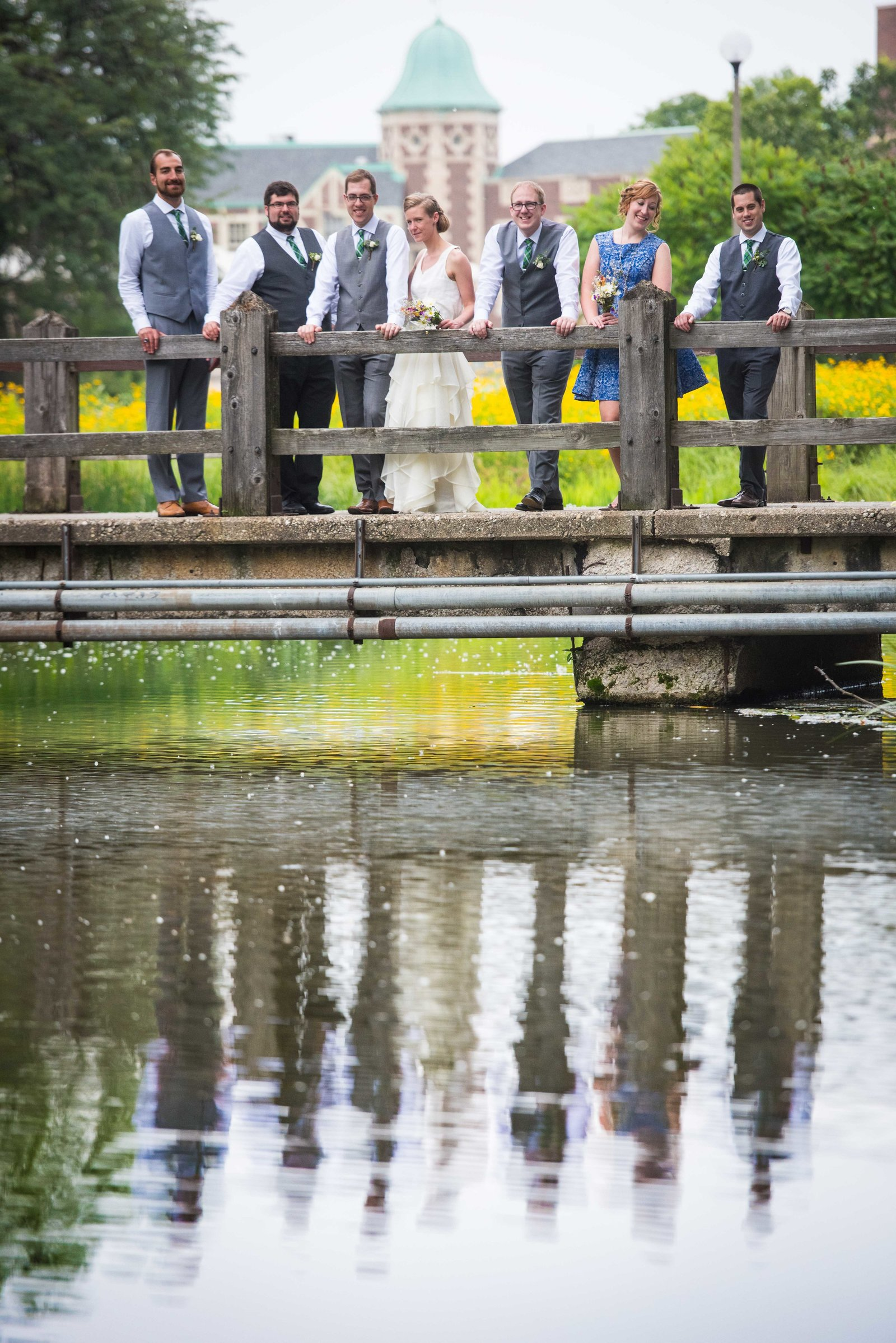 Bridal party poses on bridge at Humboldt Park, Chicago.