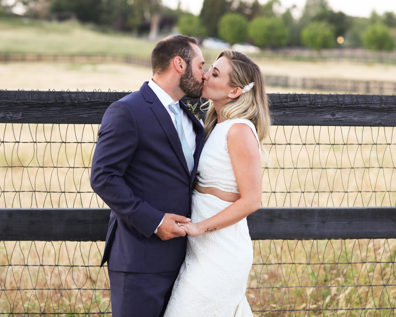 Bride and groom kiss, beautiful wedding in a rustic setting