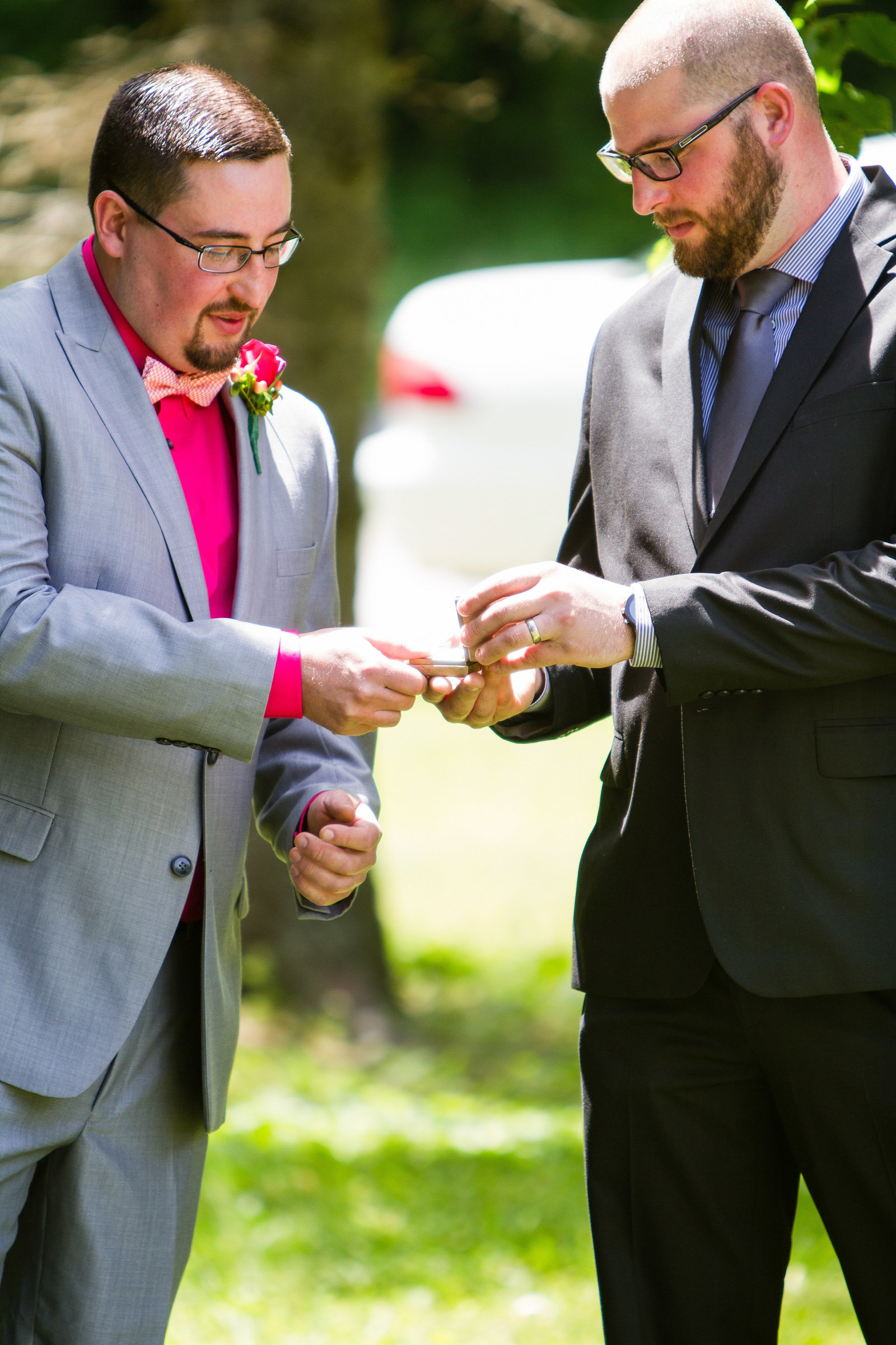 wedding photography groom best-man ring exchange