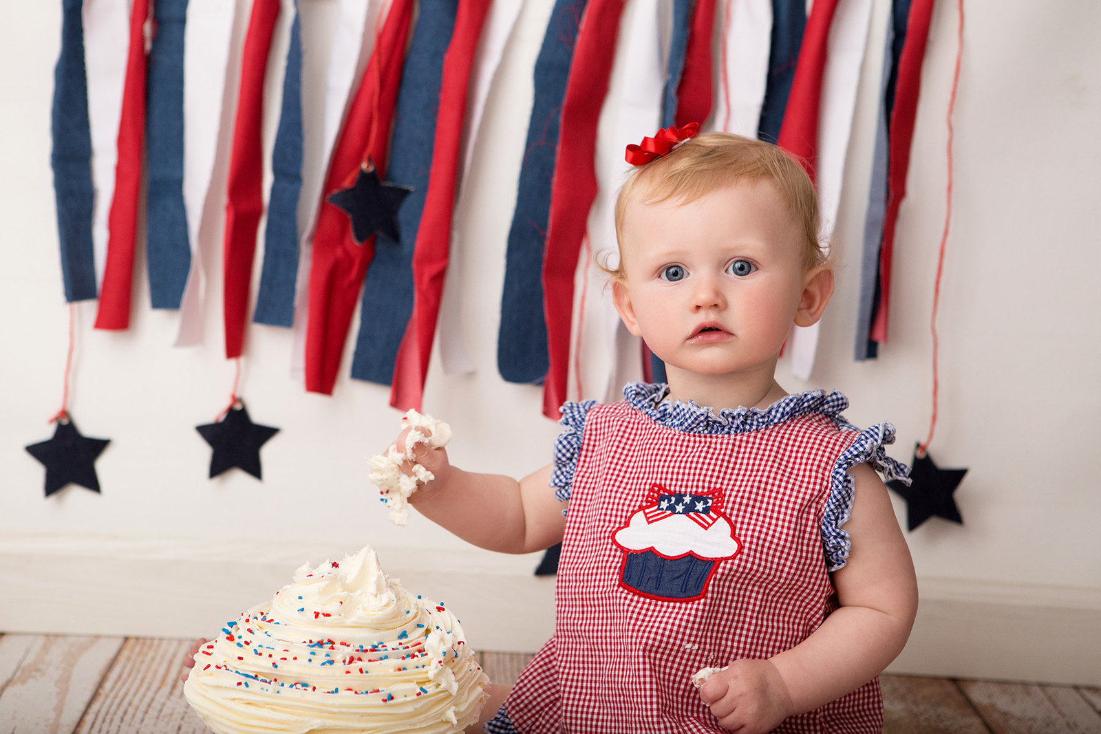 First birthday cake smash pictures by Hudson Valley professional photographer in Cornwall NY photography studio