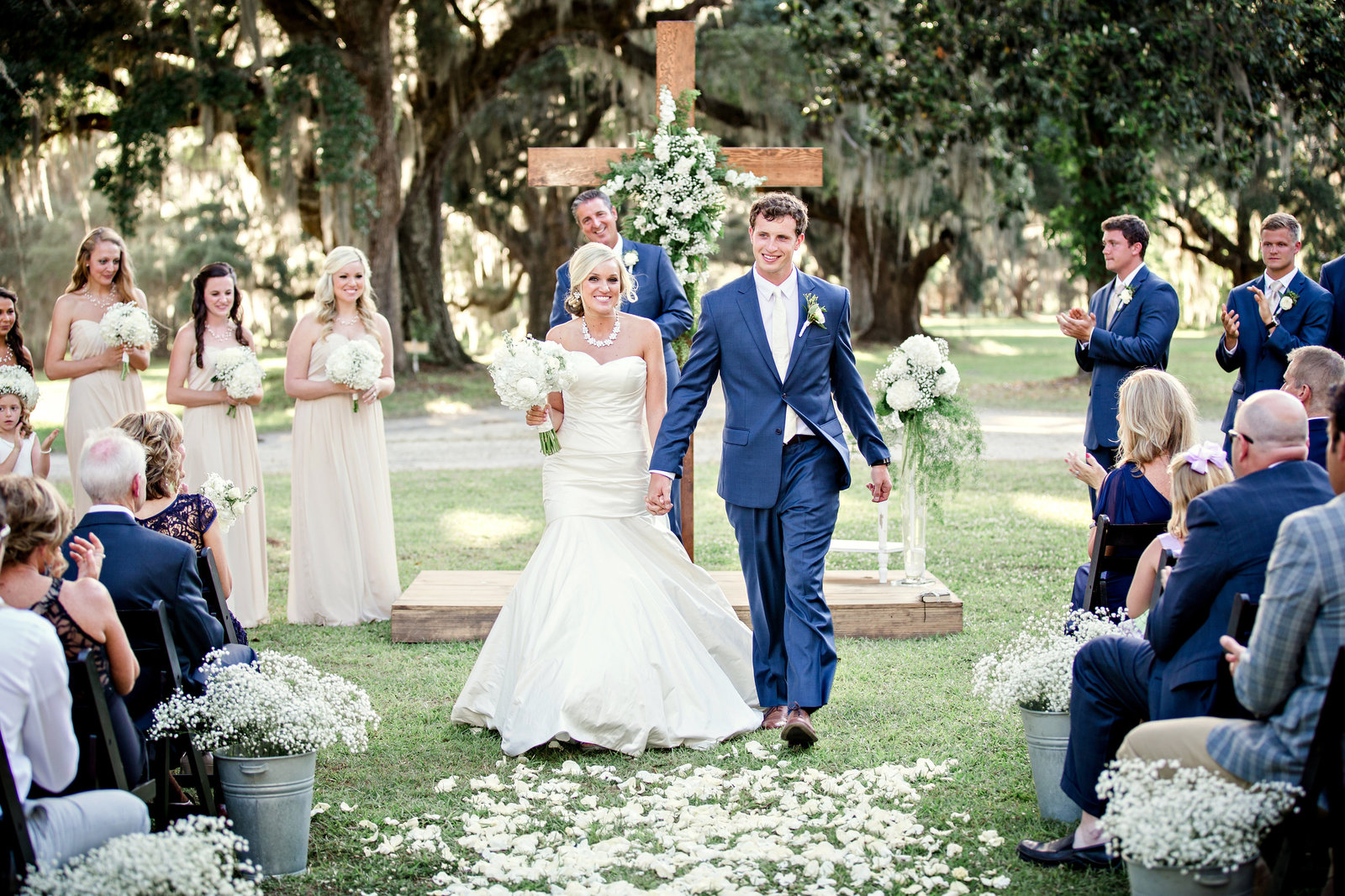 Exiting their Charleston Destination Wedding ceremony by Knoxville Wedding Photographer, Amanda May Photos.