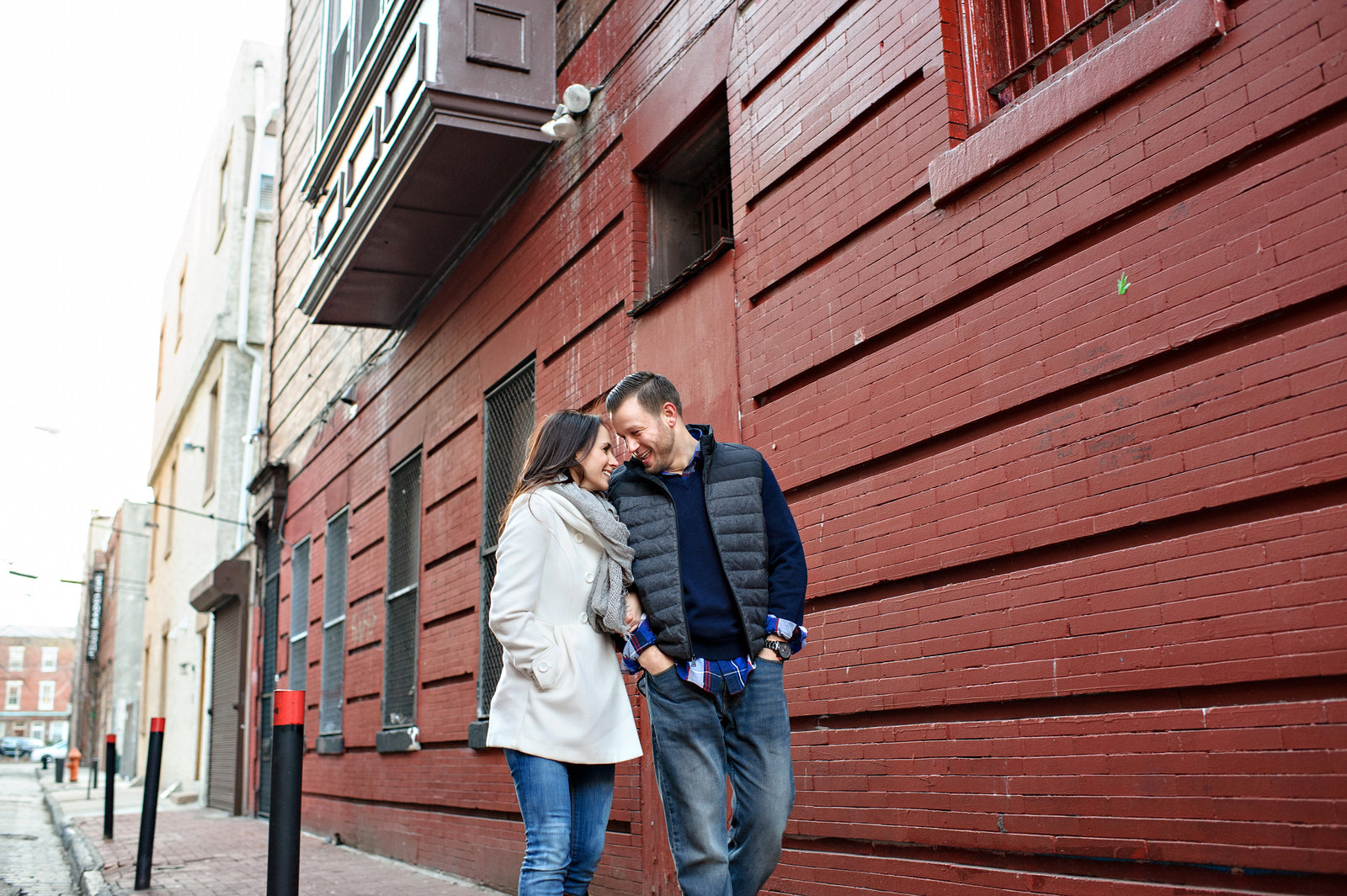 A man and his fiance walk the south philly streets while looking into each others eyes.