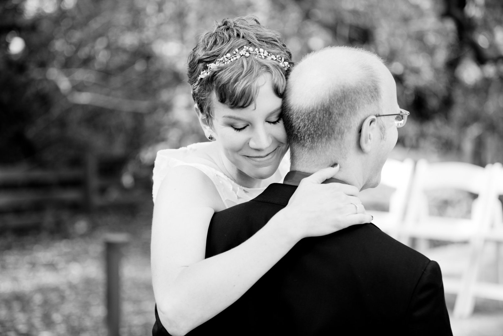 Bride and groom hug in romantic black and white portrait