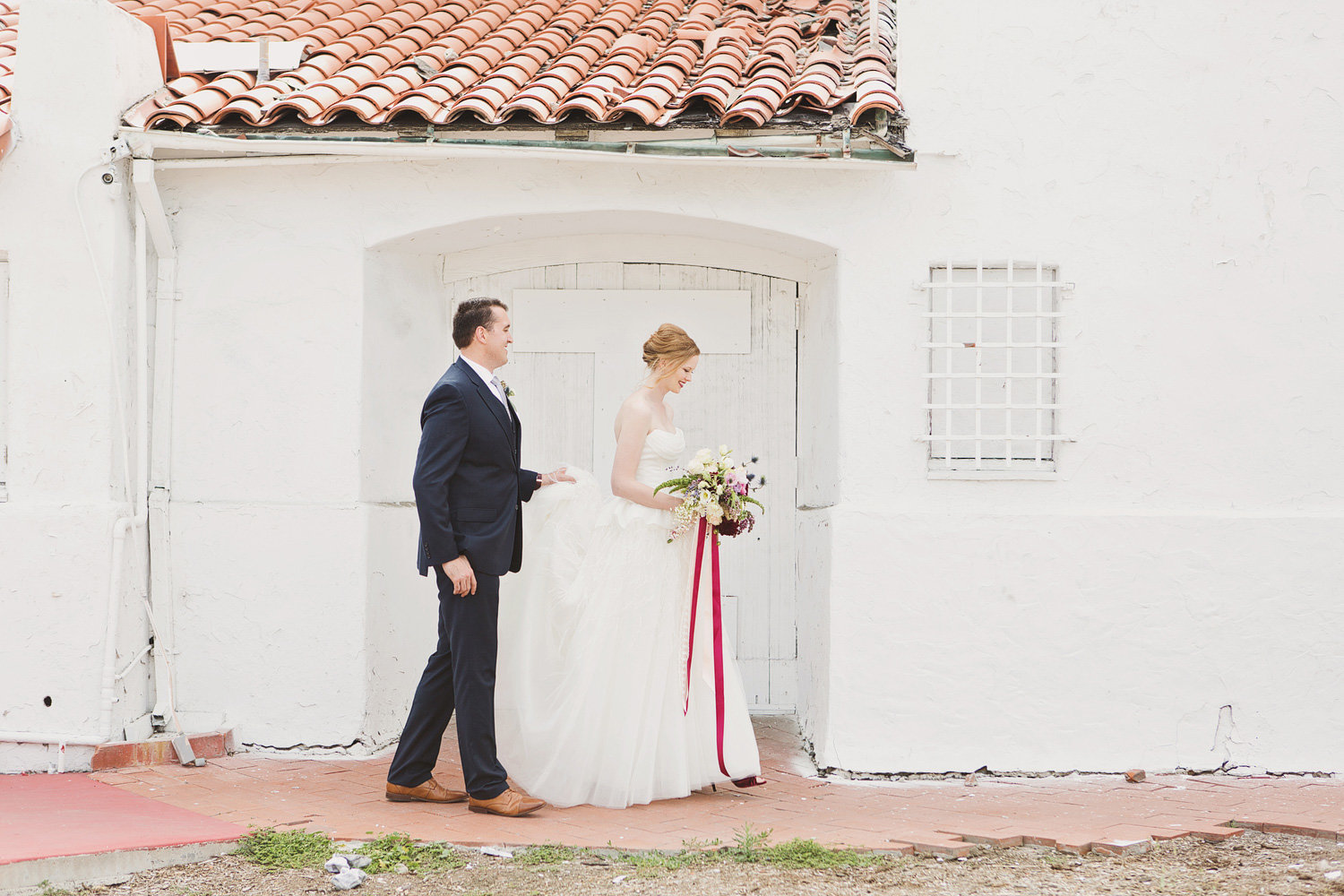 Bride and groom walking at San Clemente wedding