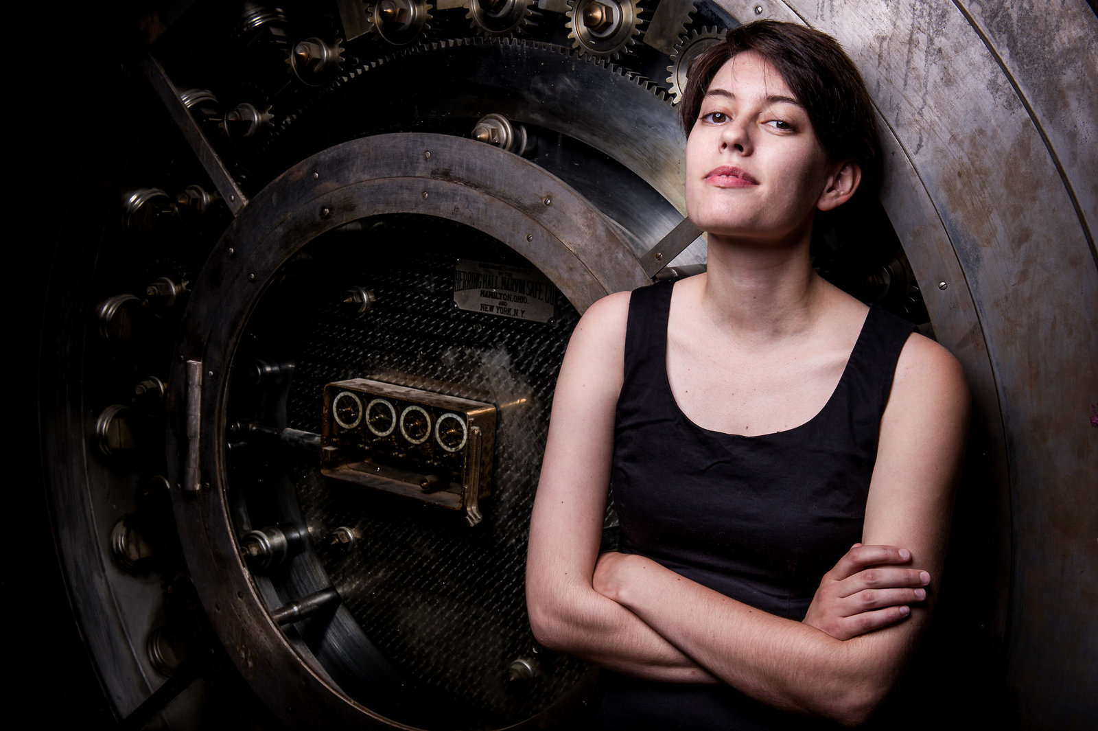 Portrait of Renee with bank vault door background.