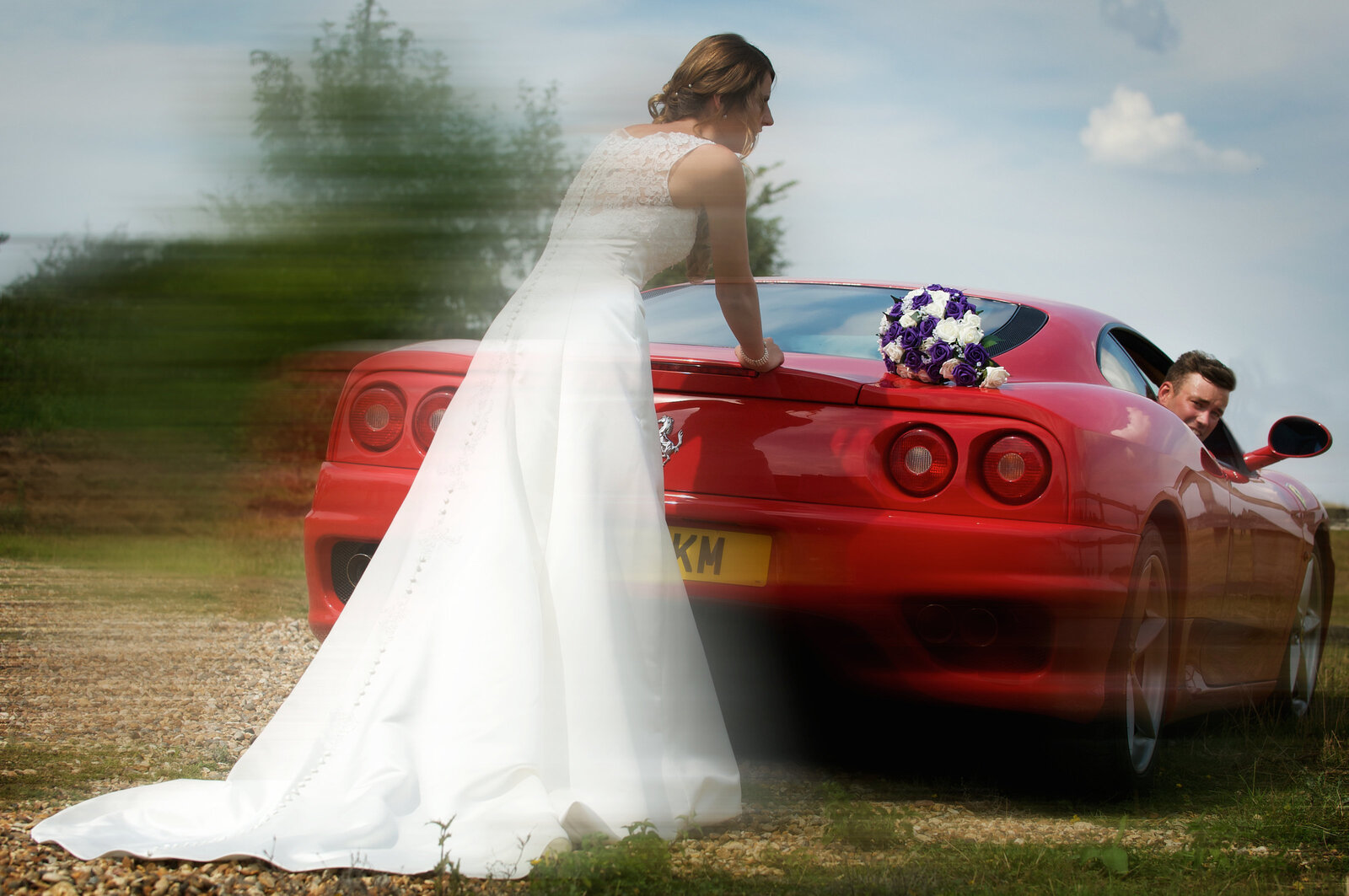 Bride pushing car