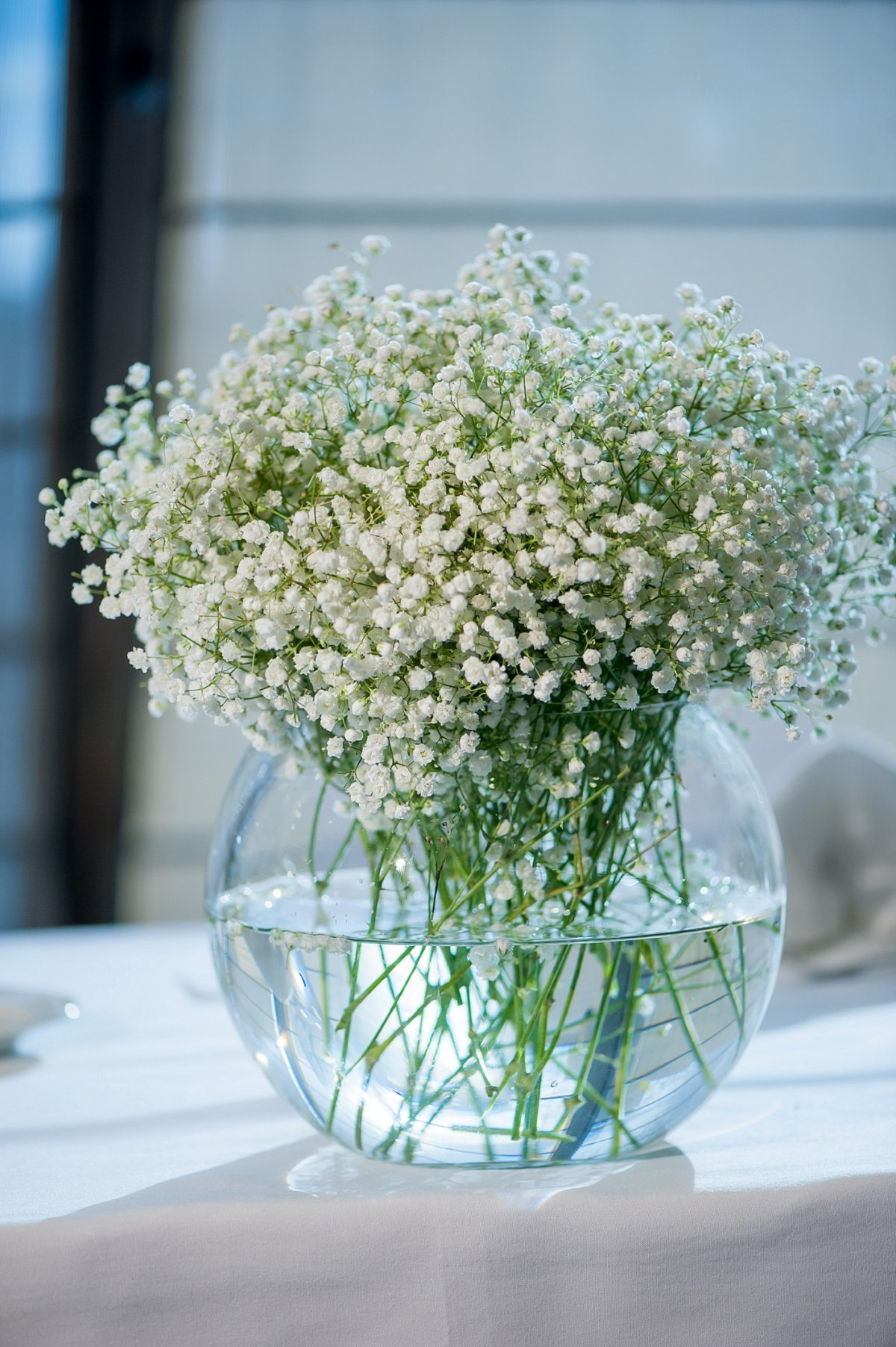 Simple beautiful baby's breath florals for weddings in Fargo Moorhead. Photos by Kriskandel.com