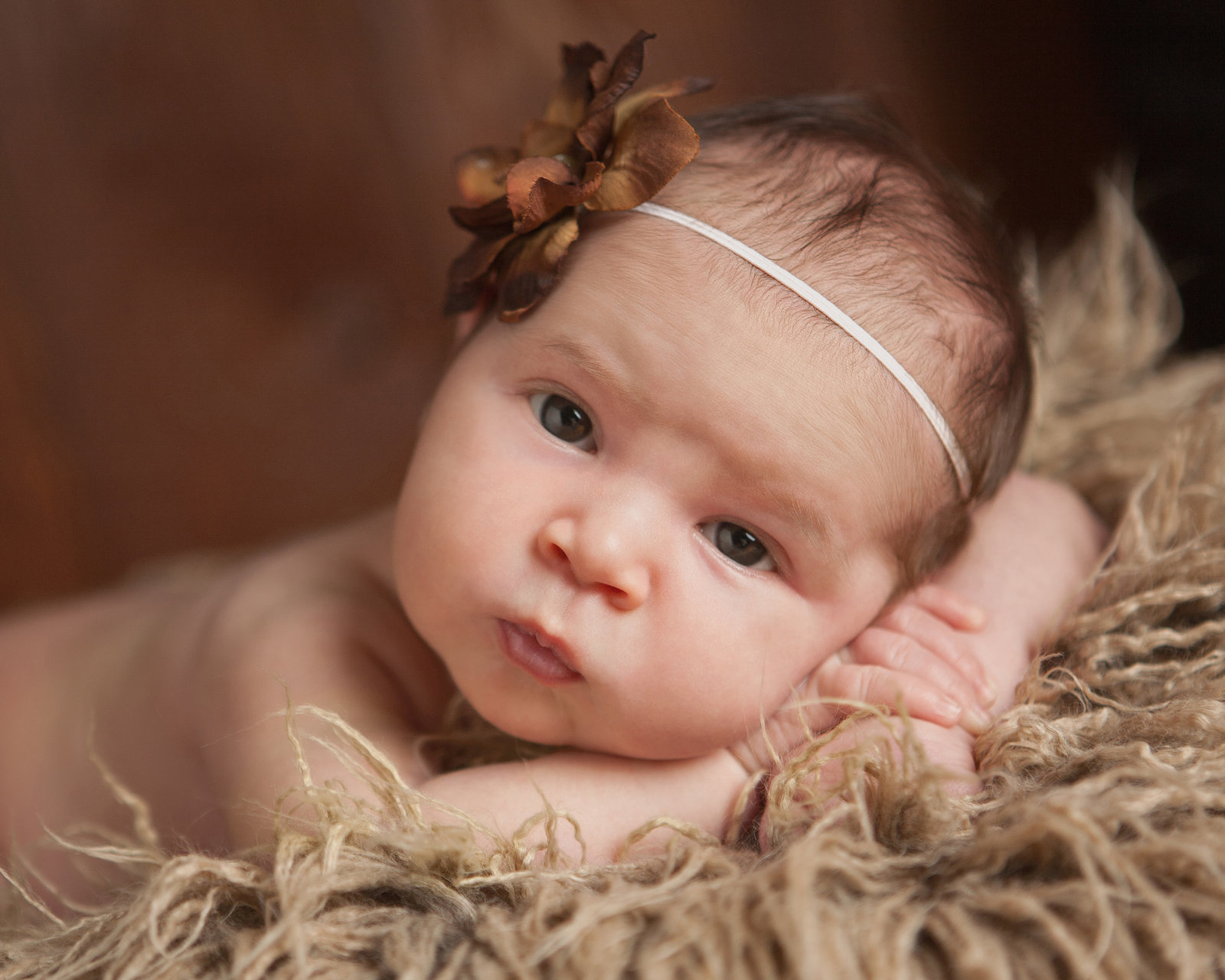Newburgh NY baby girl awake and looking at the photographer Hudson Valley professional photography Cornwall NY
