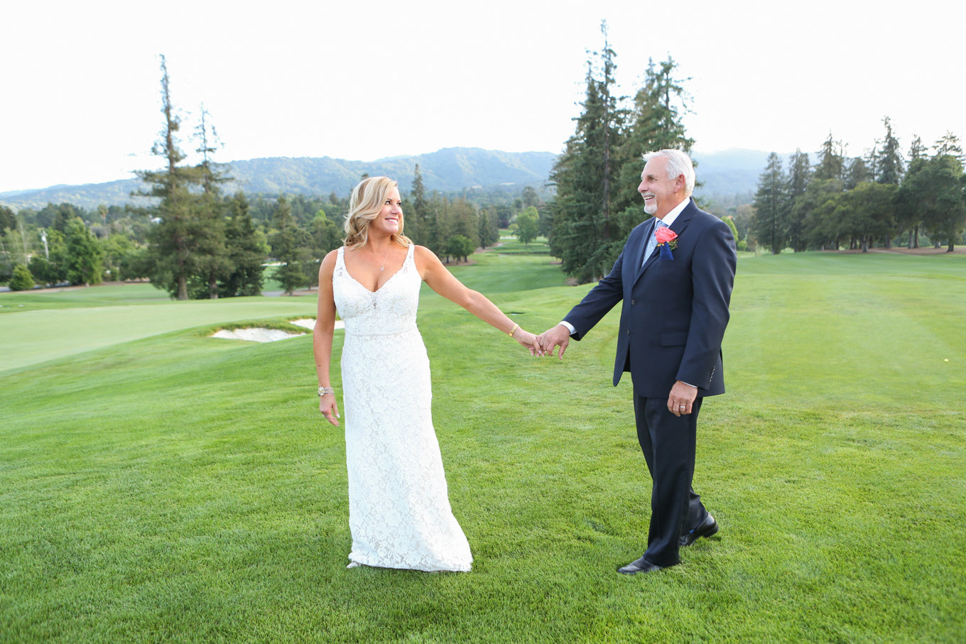 Bride and groom walk on golf course in northern california. Beautiful country club wedding