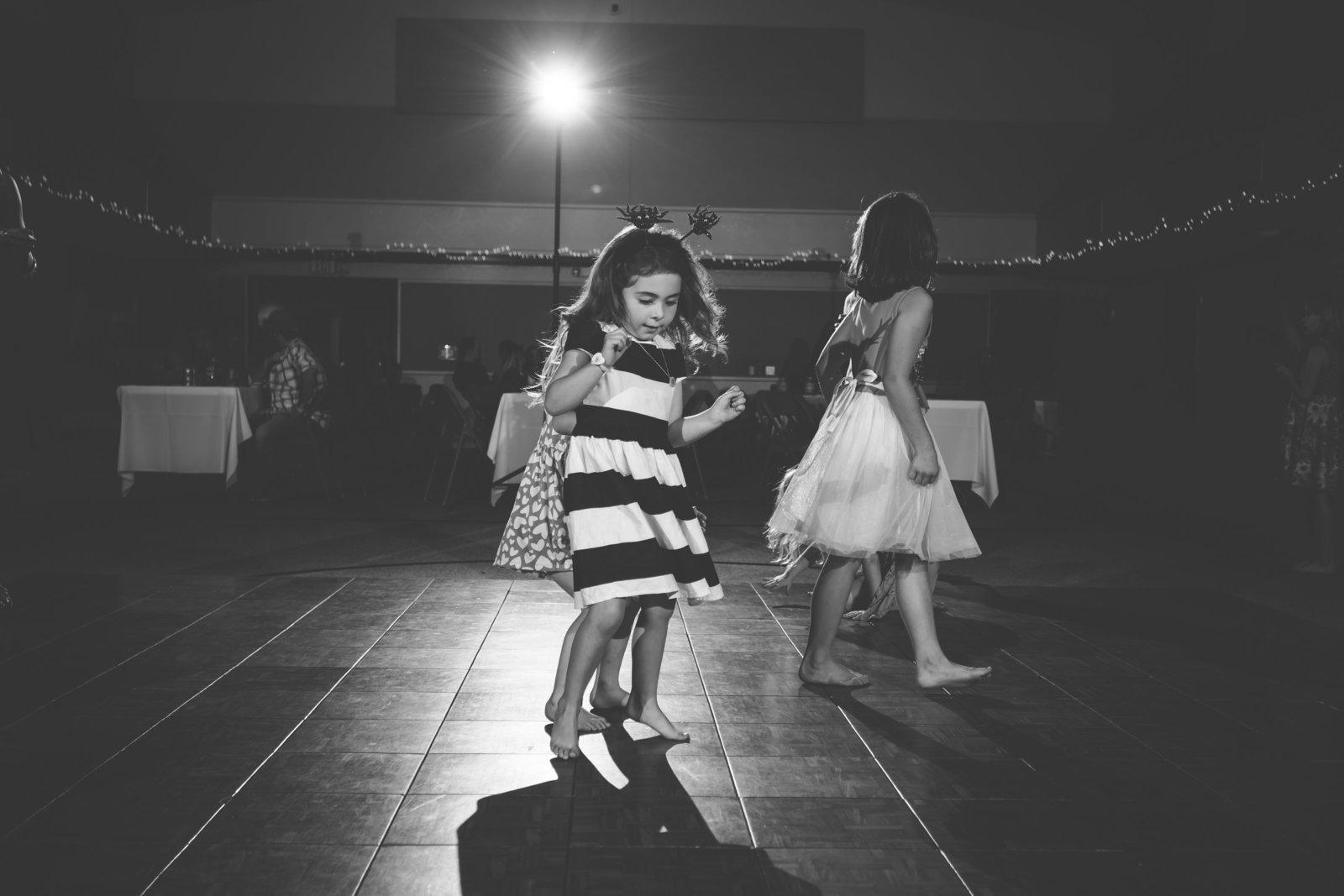 Little girl dancing at reception  in Kansas City