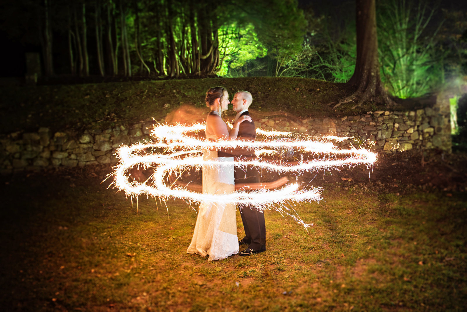Sparklers surround a newly married couple at Ridley Creek Mansion in PA.