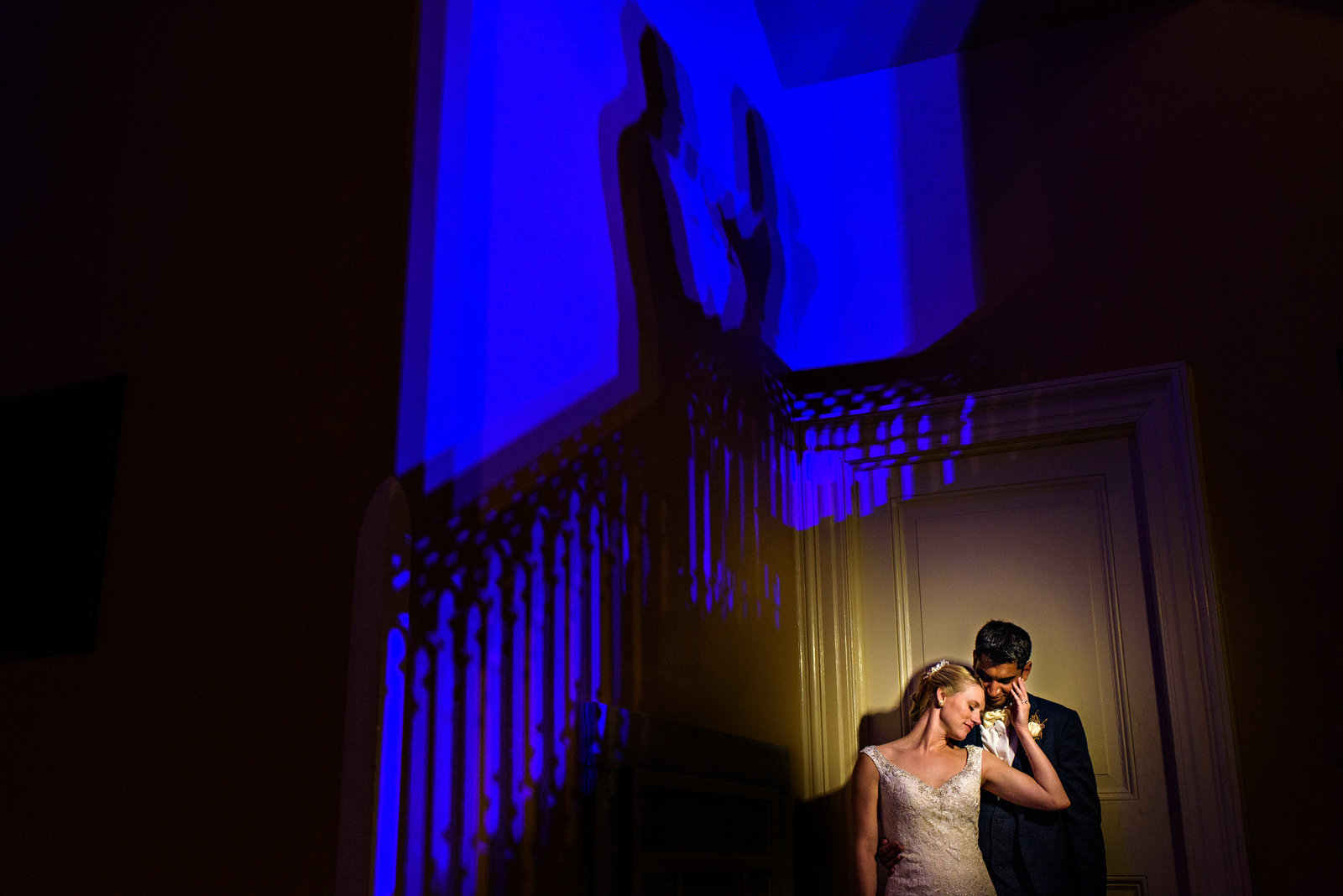 A newly married couple share a moment in the corner of the Racquet Club of Philadelphia.