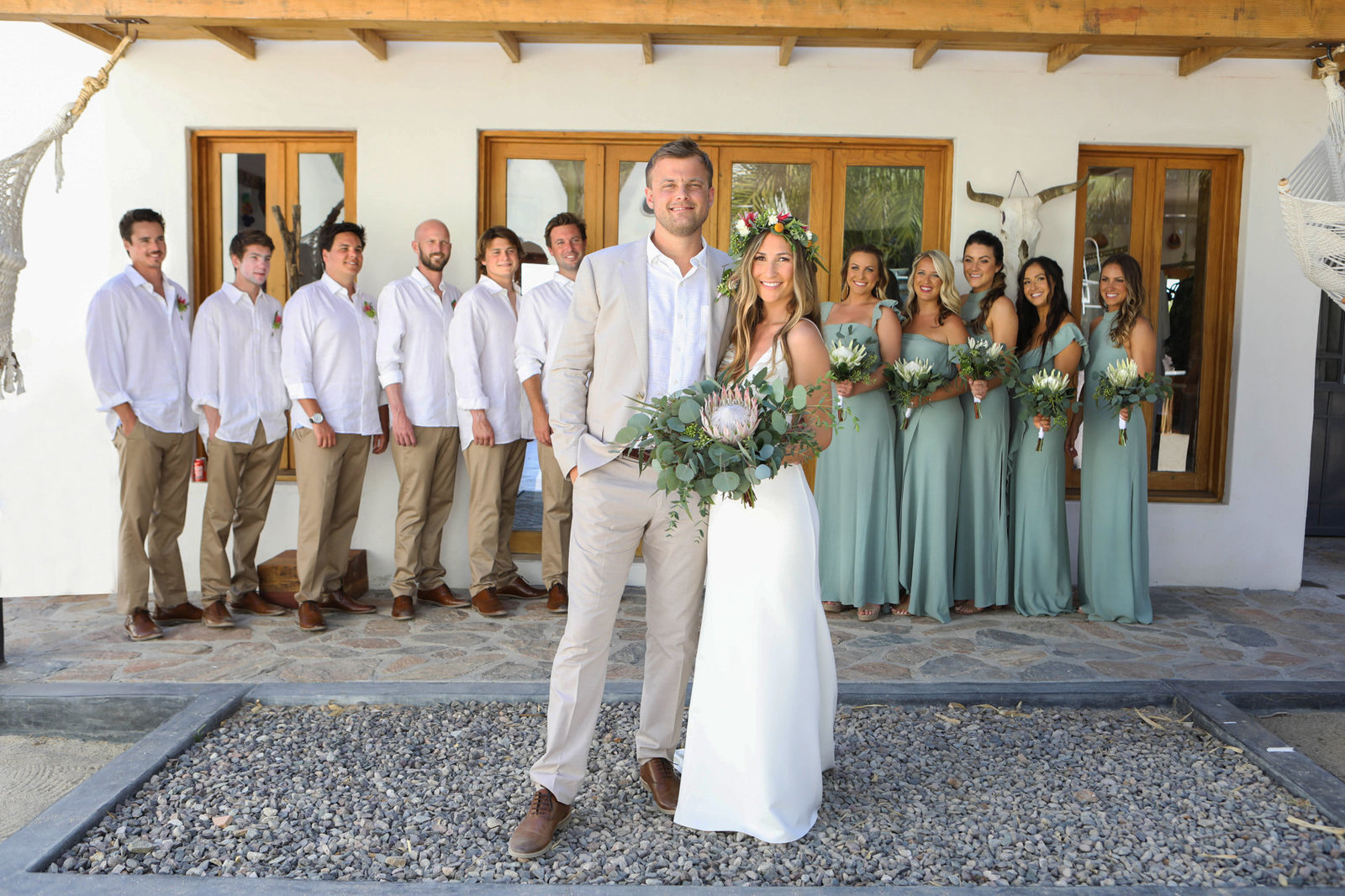 Portrait of bride and groom with bridesmaids and groomsmen, colorful wedding in Mexico