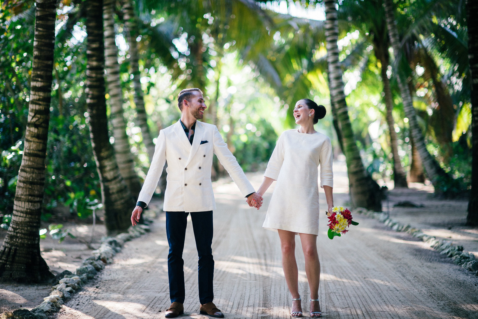 laughing bride & Groom in Coconut grove in Kamalame cay by Lyndah Wells Photography