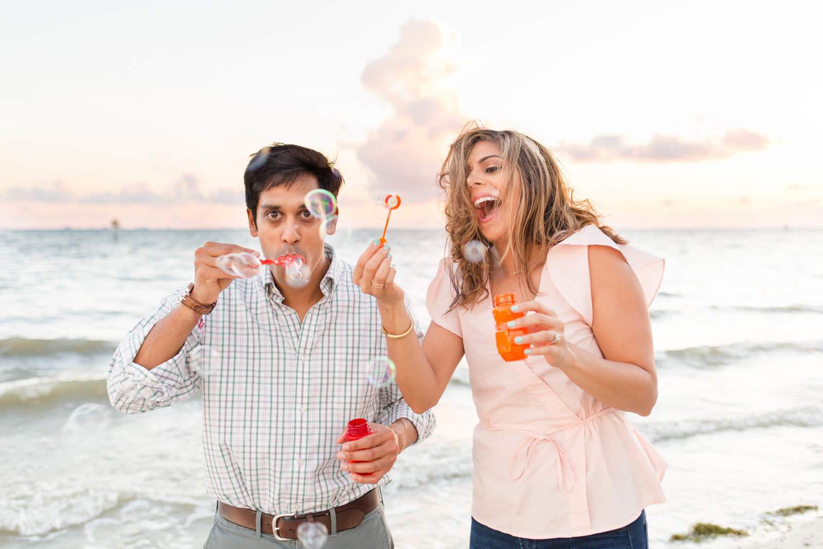 beach engagement photography fun bubbles