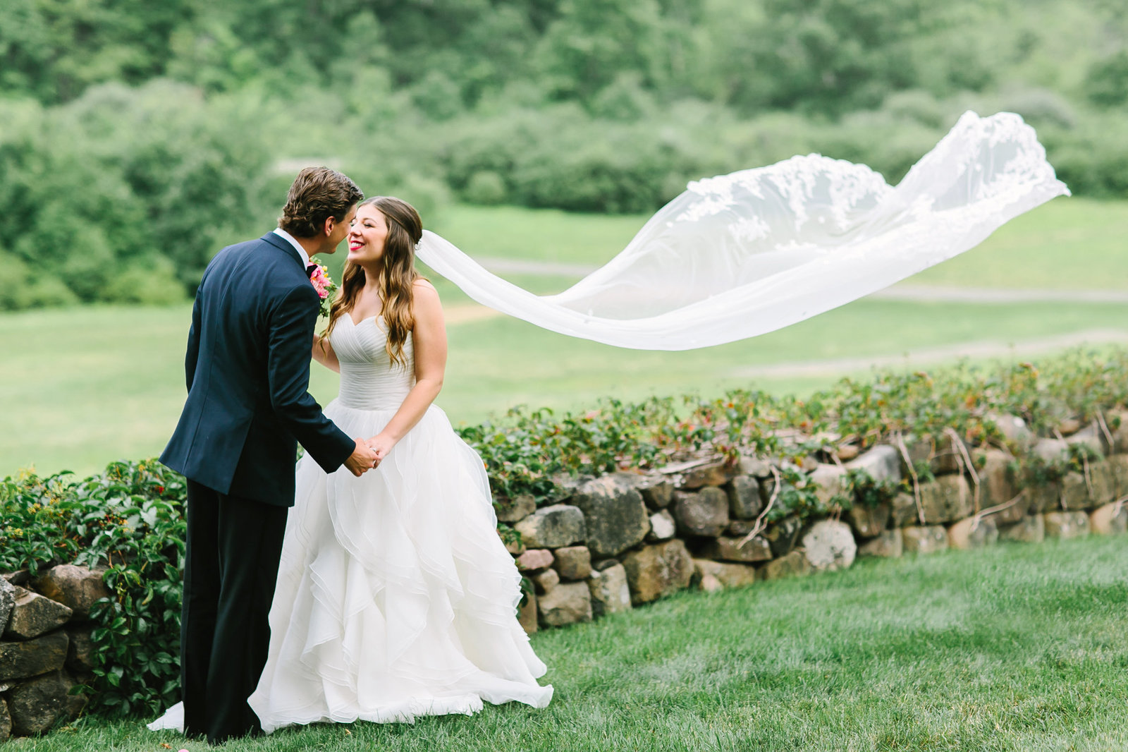 bride and groom kissing at the Hill+stead Museum
