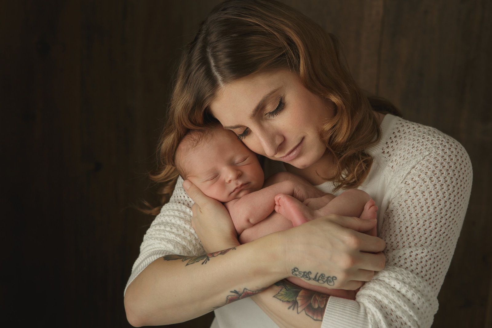 first time new mom holding her newborn baby Hudson Valley NY professional photographer in Cornwall NY