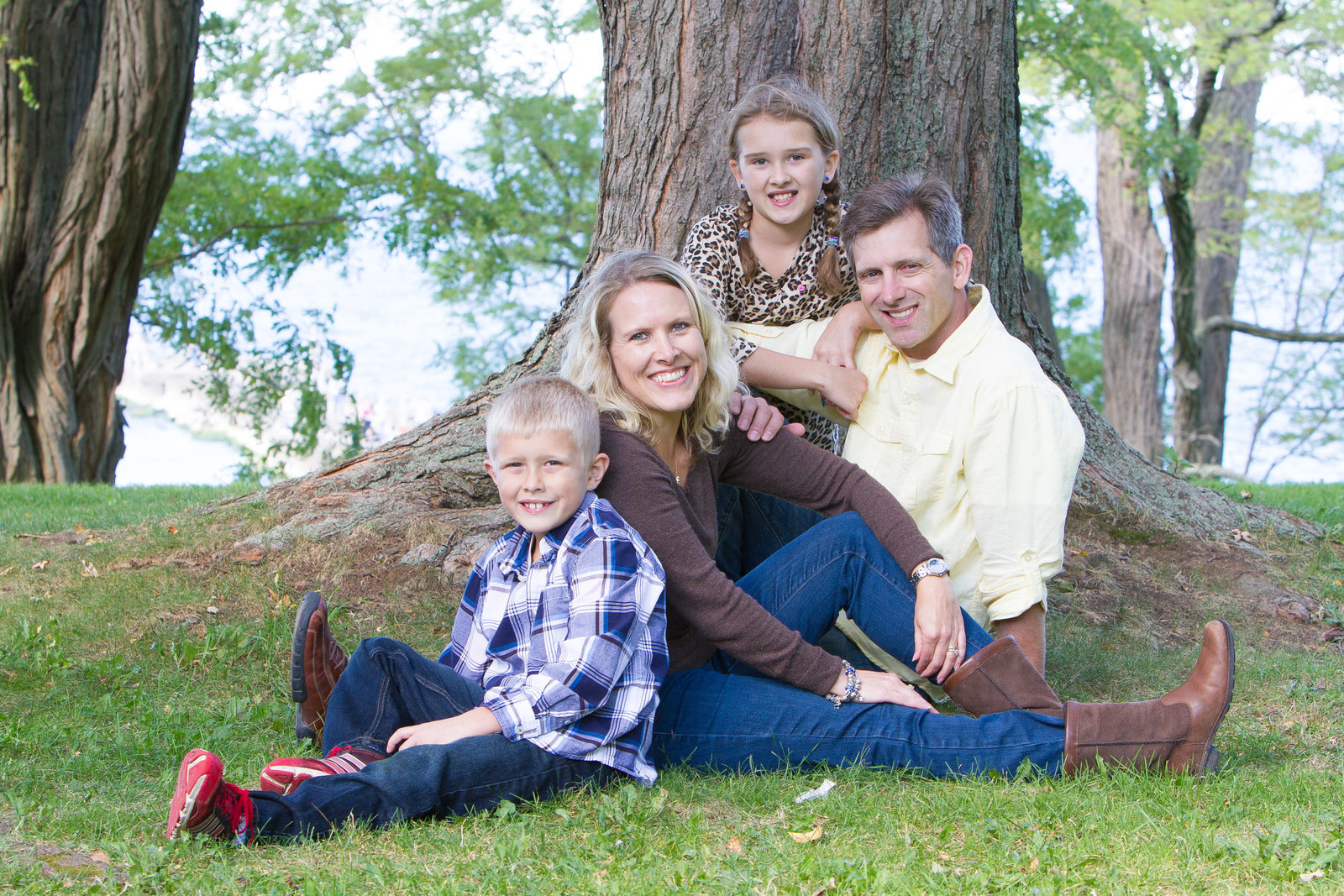 Famil portrait by tree in grass