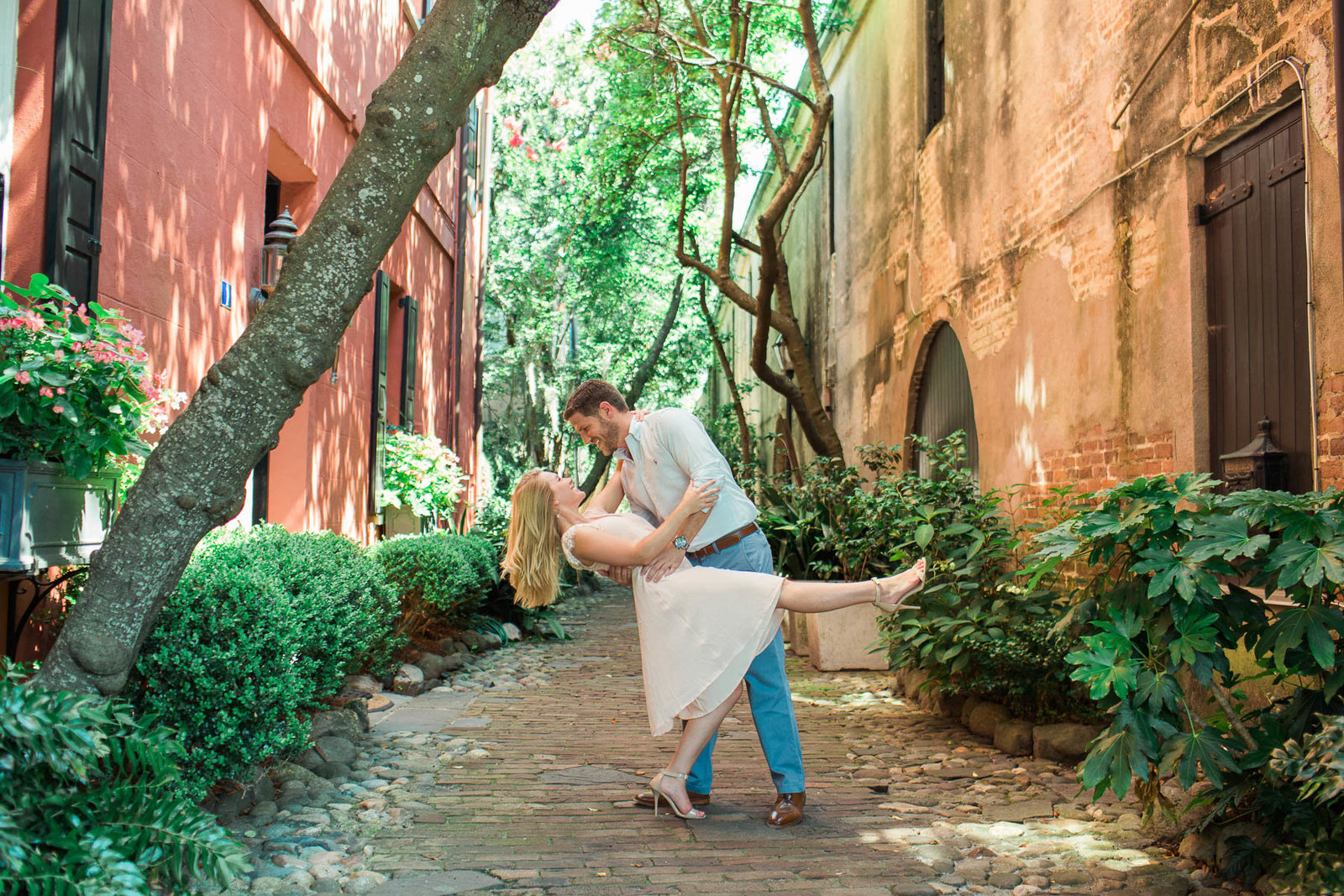 Engaged couple dip in Philadelphia Alley, Downtown Charleston, South Carolina