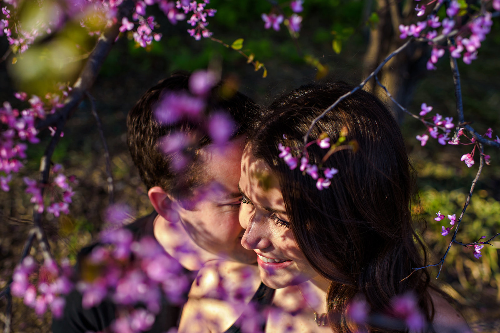 Flowers cast shadows on a couples faces.