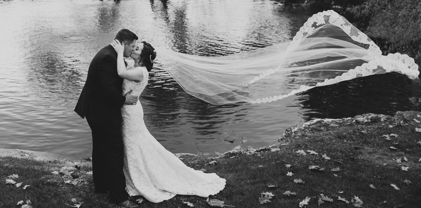 a bride and groom with a romantic veil shot at the farm at eagles ridge