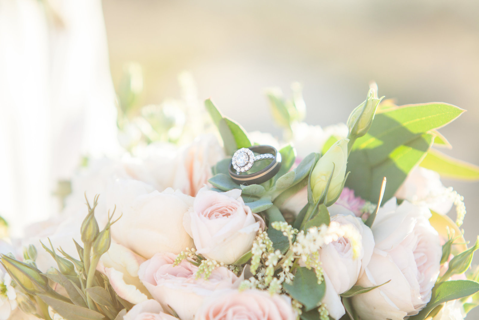 Joshua Tree wedding ring and flower bouquet photo natural light
