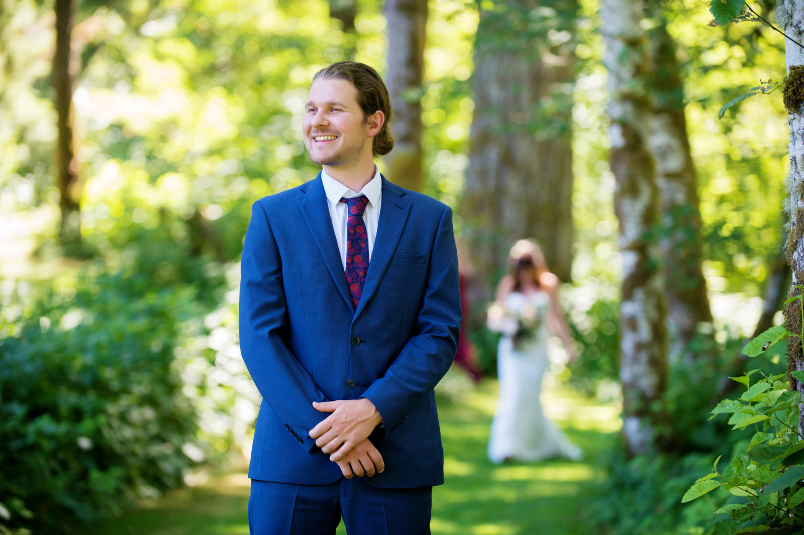 groom anxiously awaits seeing bride for the first time