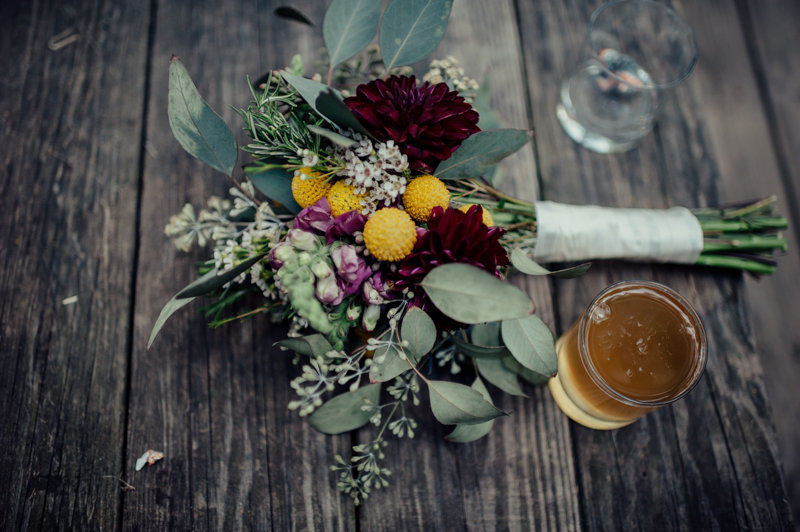 flowers sit on a table at outdoor wedding