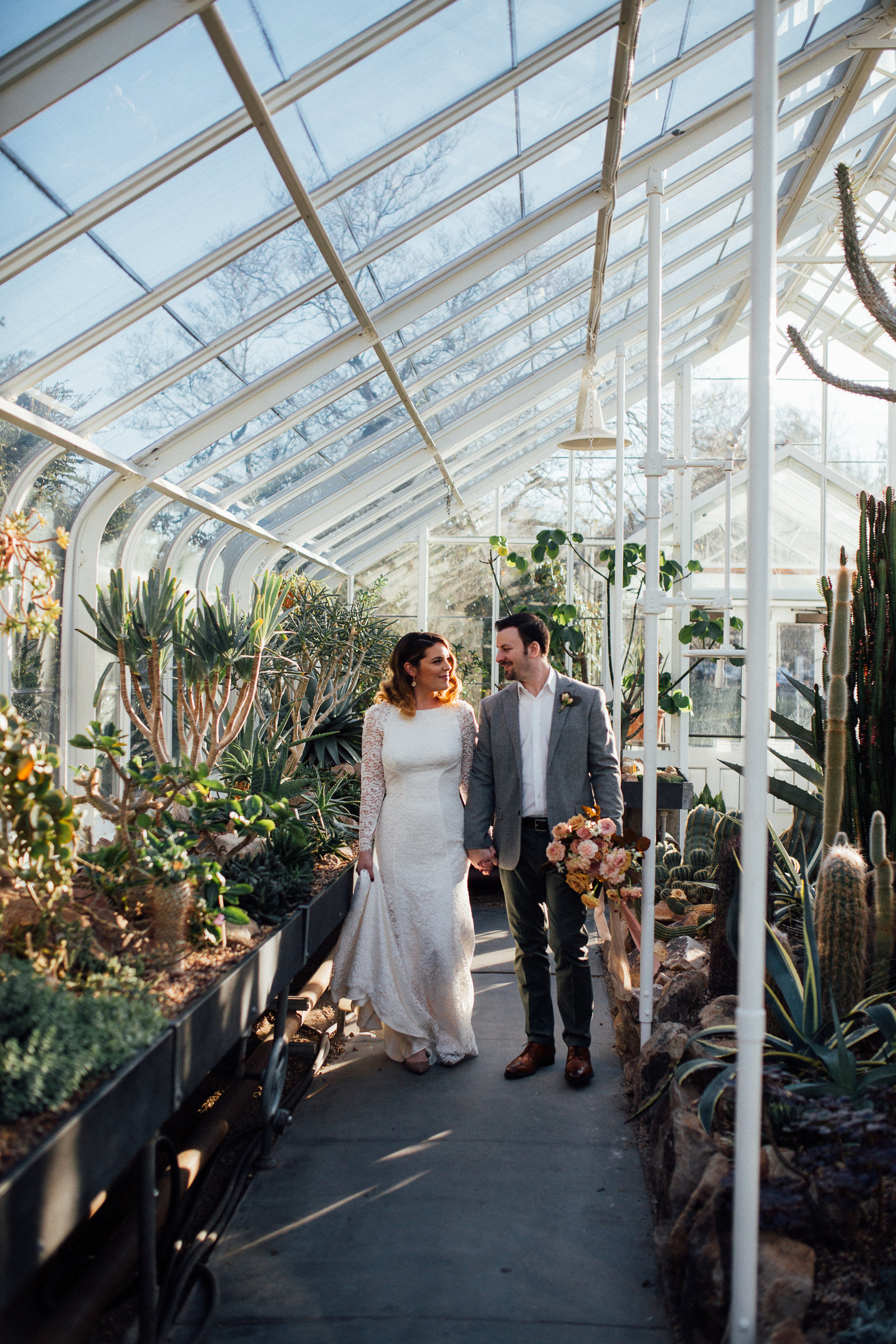 Bride and Groom walking in Seattle Wa Volunteer Park Conservatory.