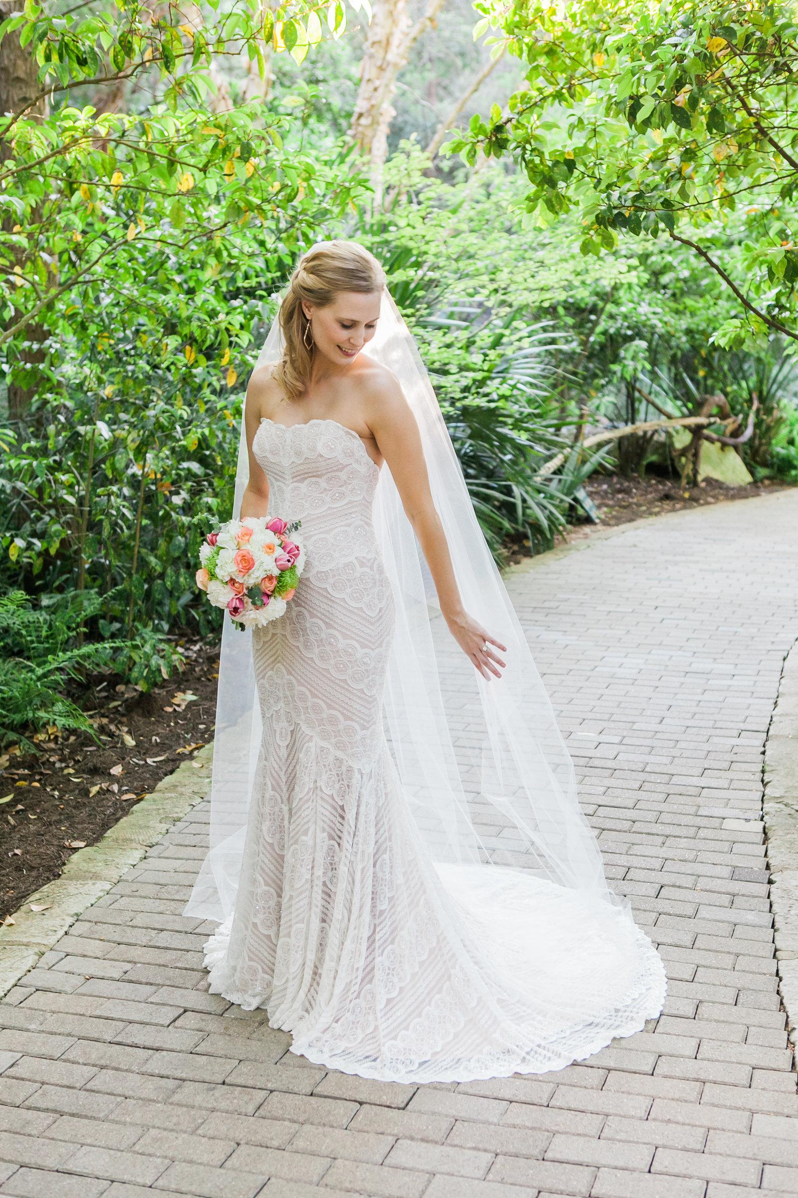 Austin Family Photographer, Tiffany Chapman, bride looking at veil