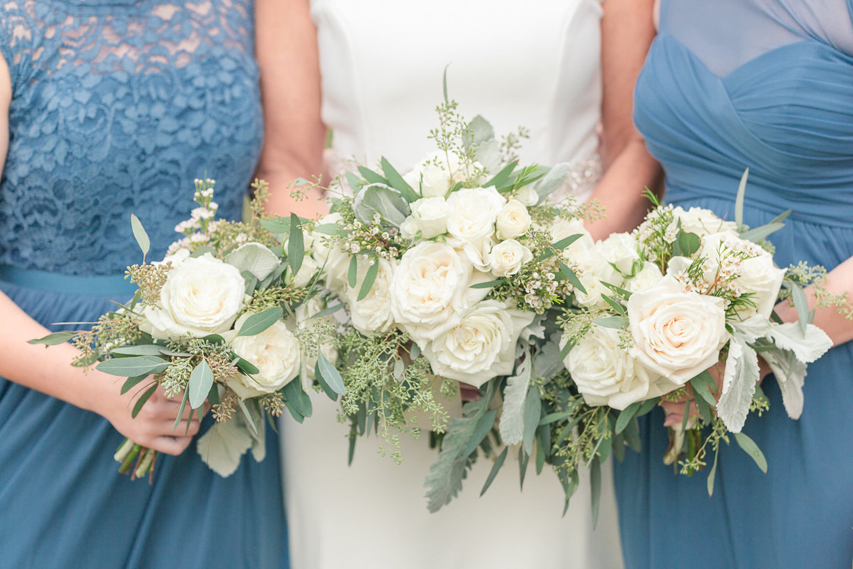 white bouquets with blue dresses