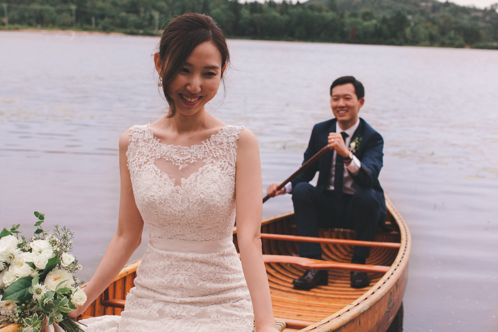 bride and groom in a canoe on the lake