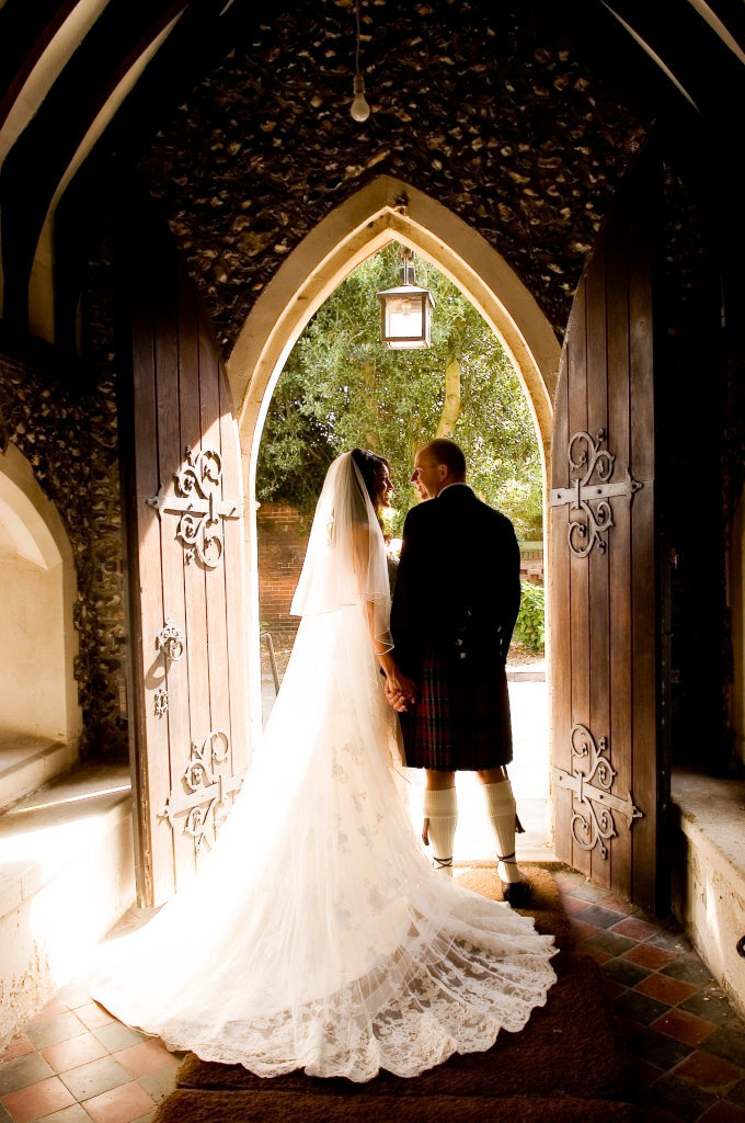 bride and groom by door