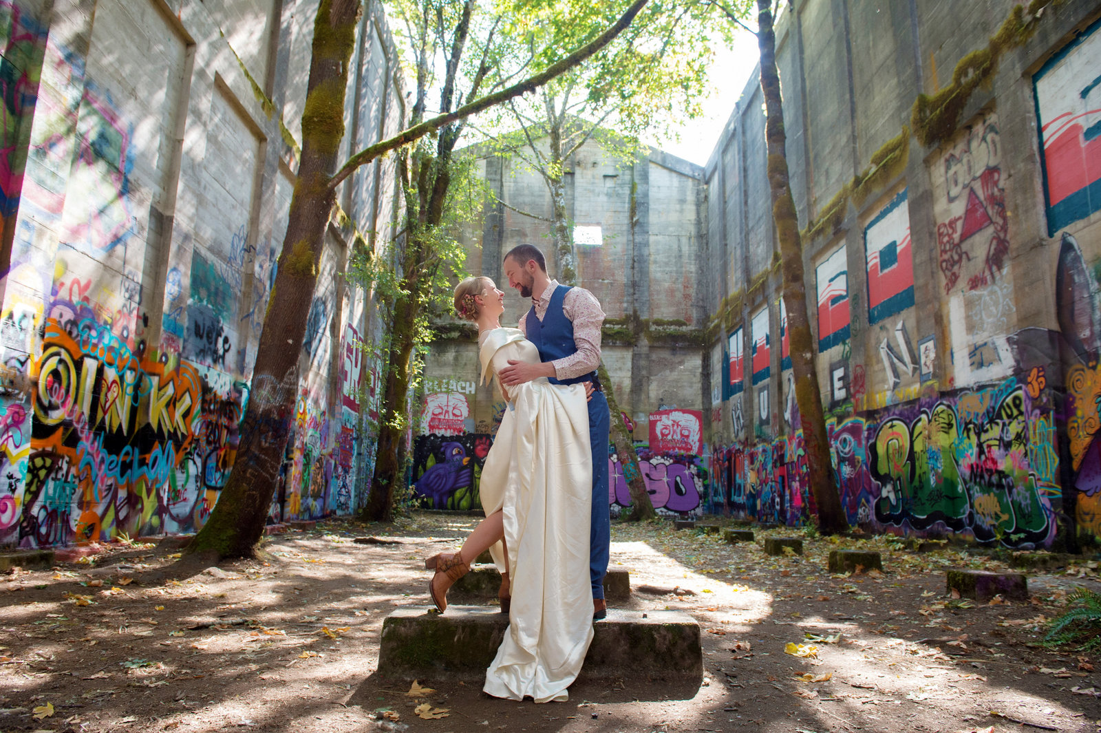 bride and groom in graffiti building in oregon