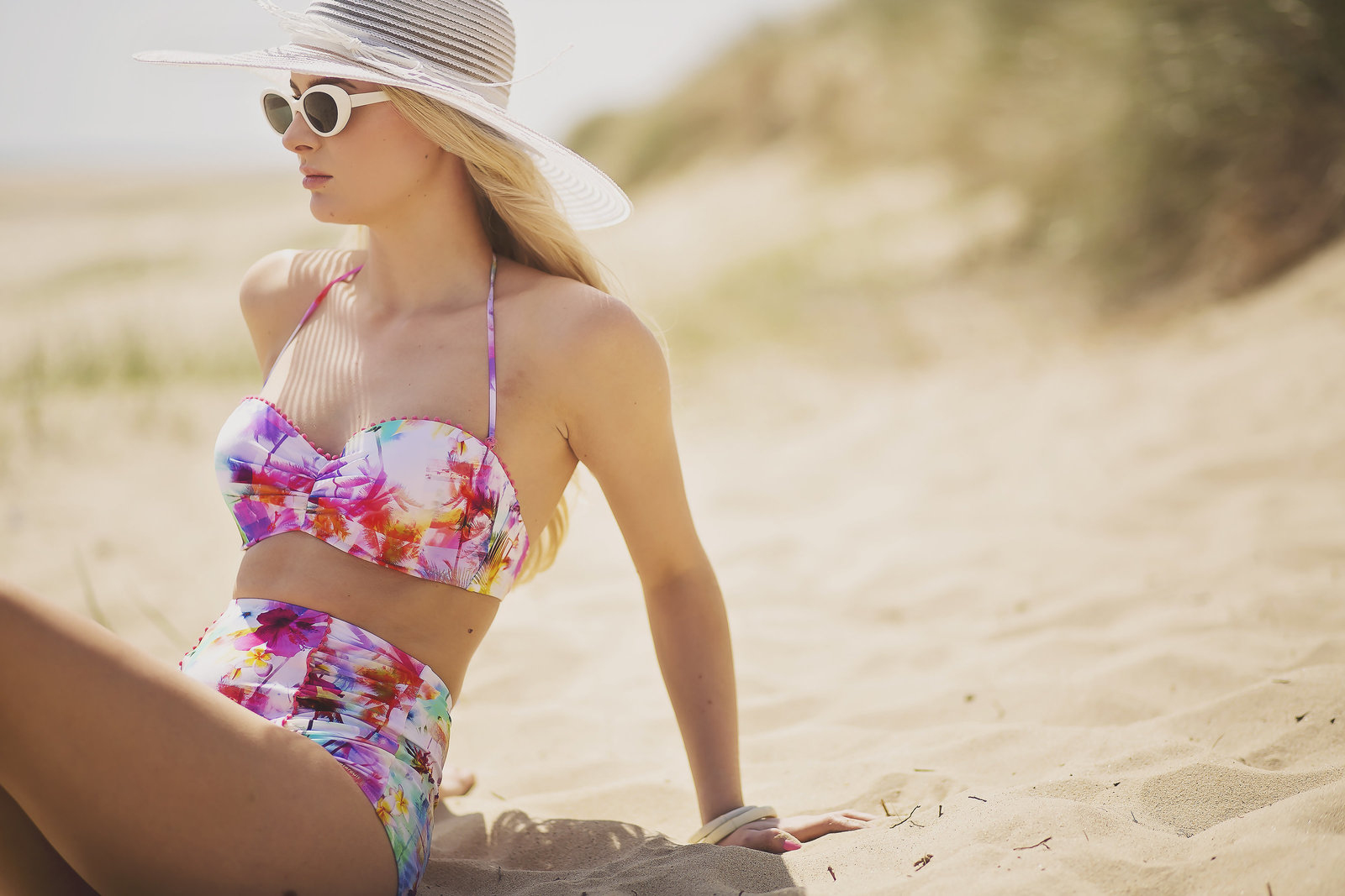 Model Eva Ruestyle wearing a floral bikini from proudlock and harry in Norwich. Photography by Jessica Elisze