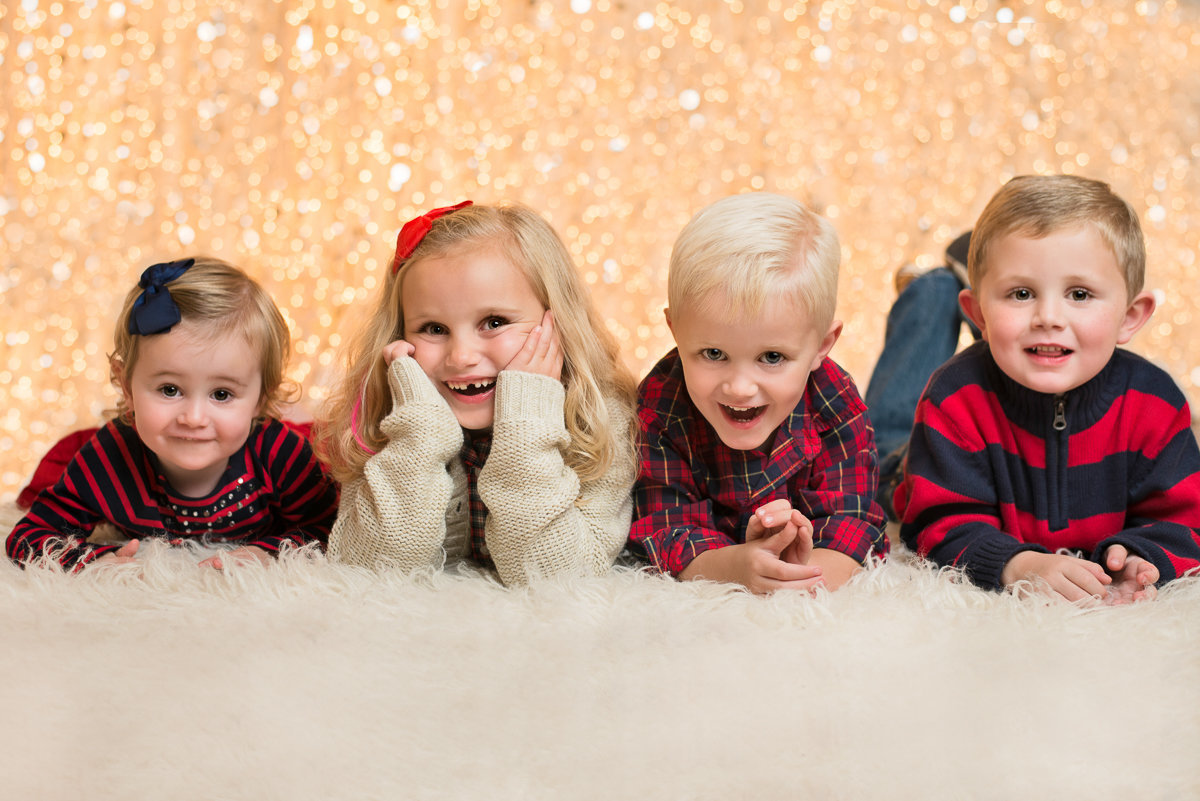 caitlin-chadwick-studios-holiday-mini-portrait-session-beautiful-children-siblings-smiles-bright-eyes-gold-glitter-festive