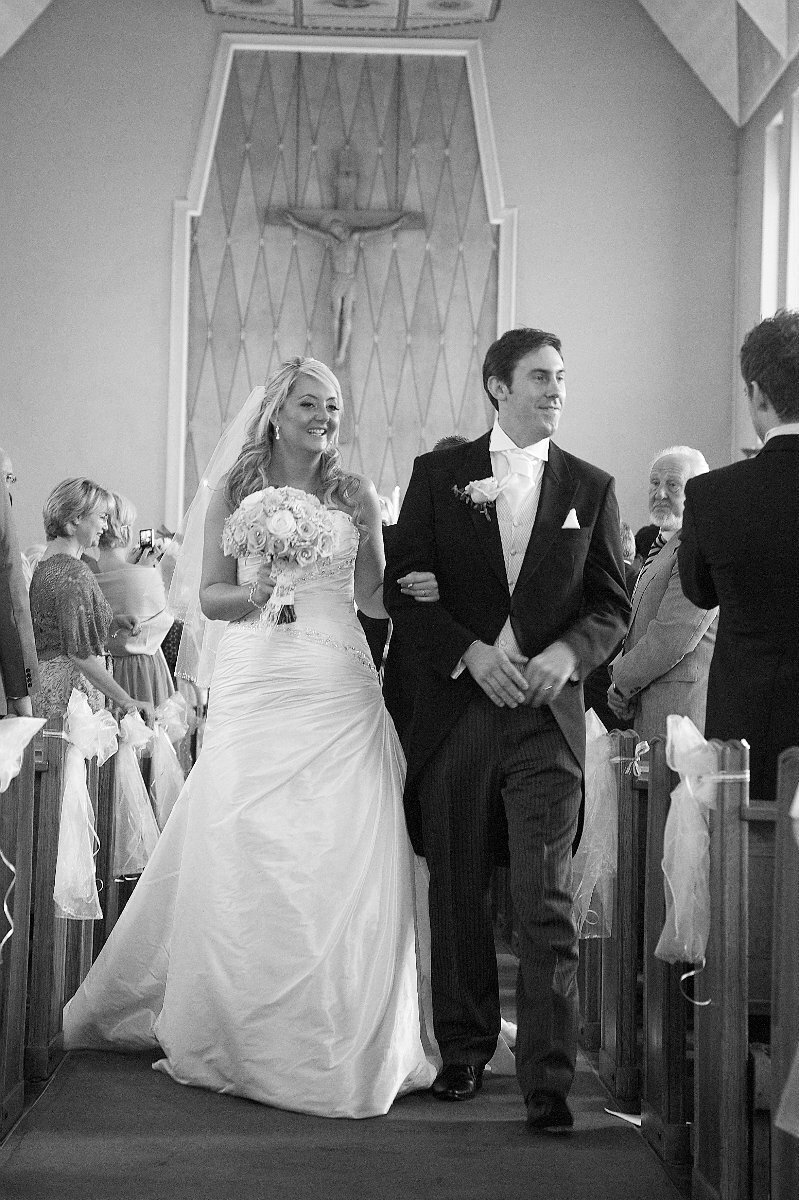 Bride & Groom walking down isle