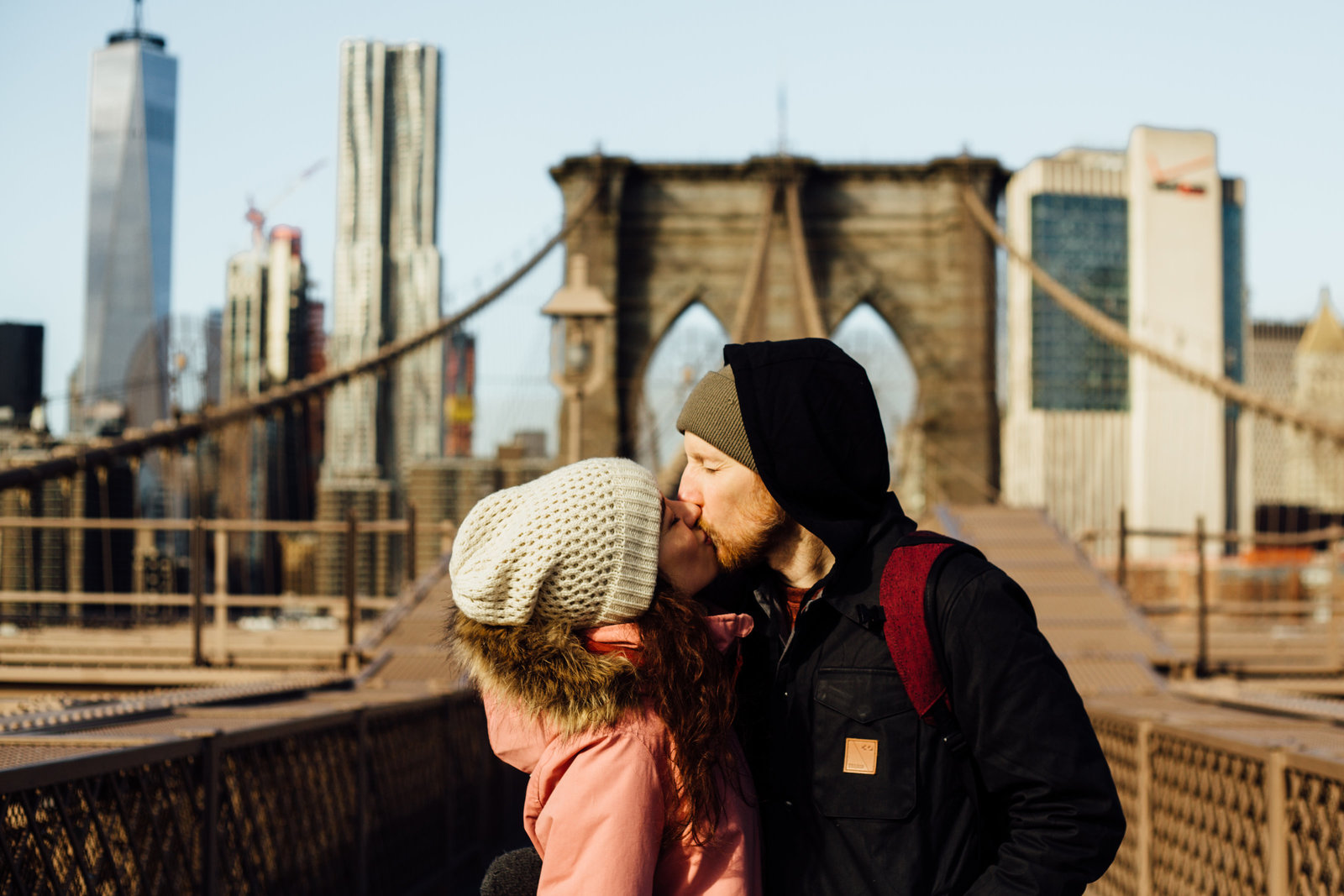 Kissing in front of Brooklyn Bridge in New York City