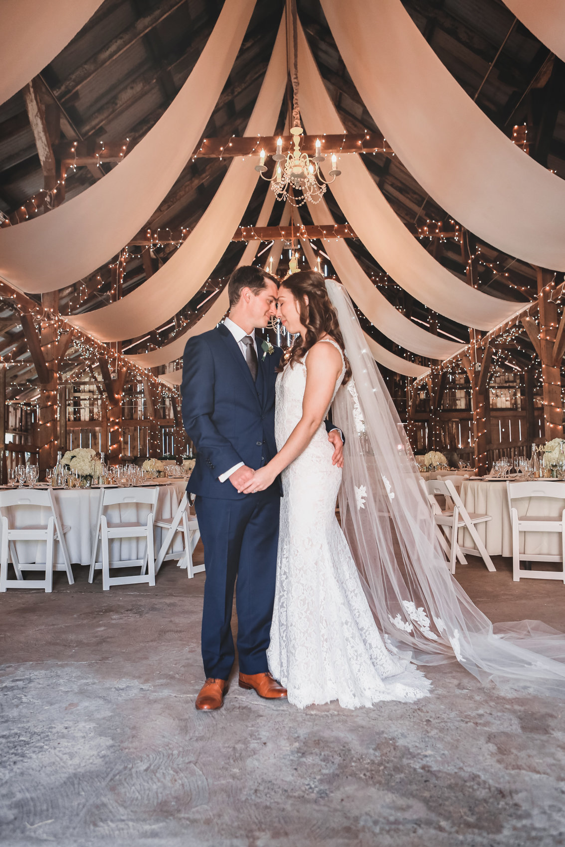 Tented rustic wedding provides beautiful backdrop for portrait of bride and groom