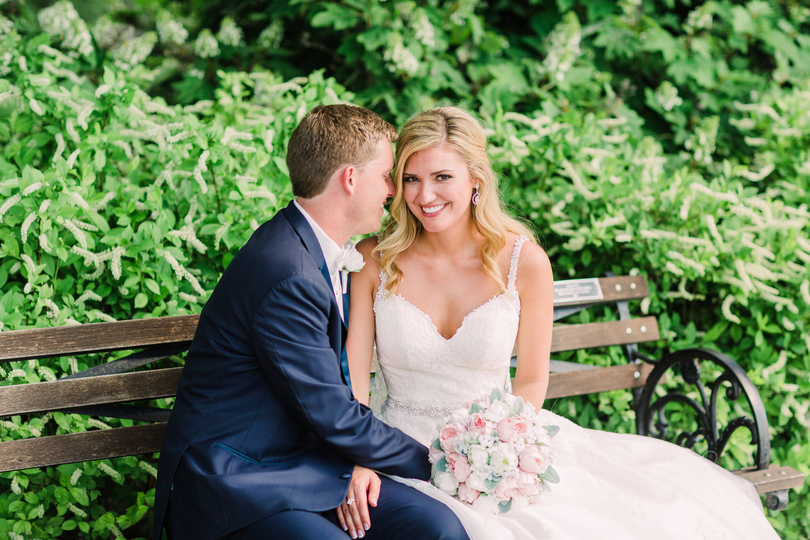 Bride and Groom seek shade near the Grand Basin at Forest Park on a park bench.