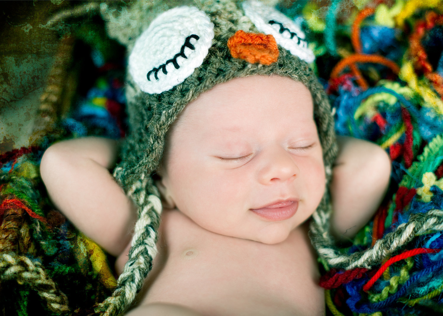 smiling sleeping newborn in hat by homeschoolma