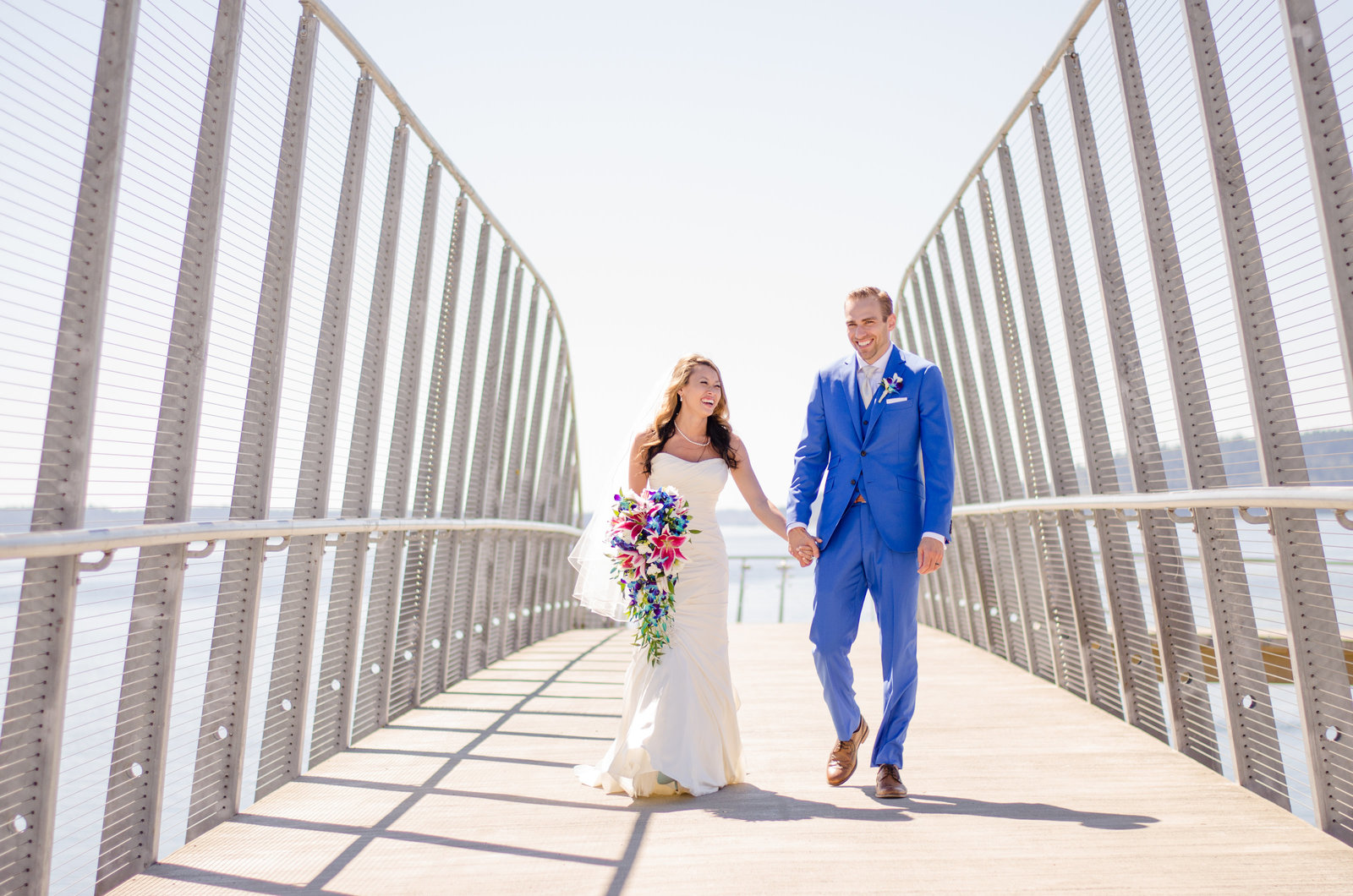 Couple holding hands on bridge