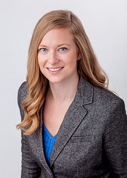 female corporate headshot on white backdrop
