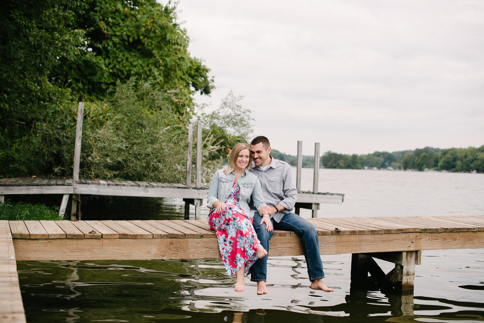 Guilford Lake couple sitting on dock