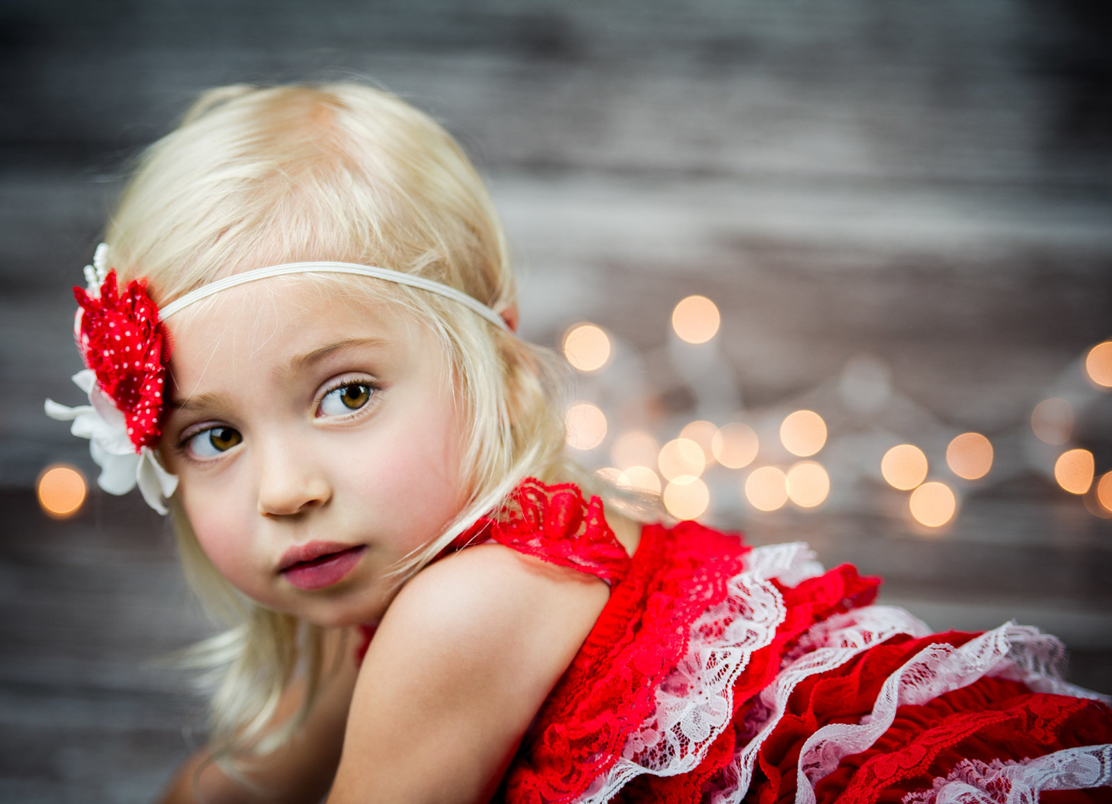 little girl in red and white christmas romper