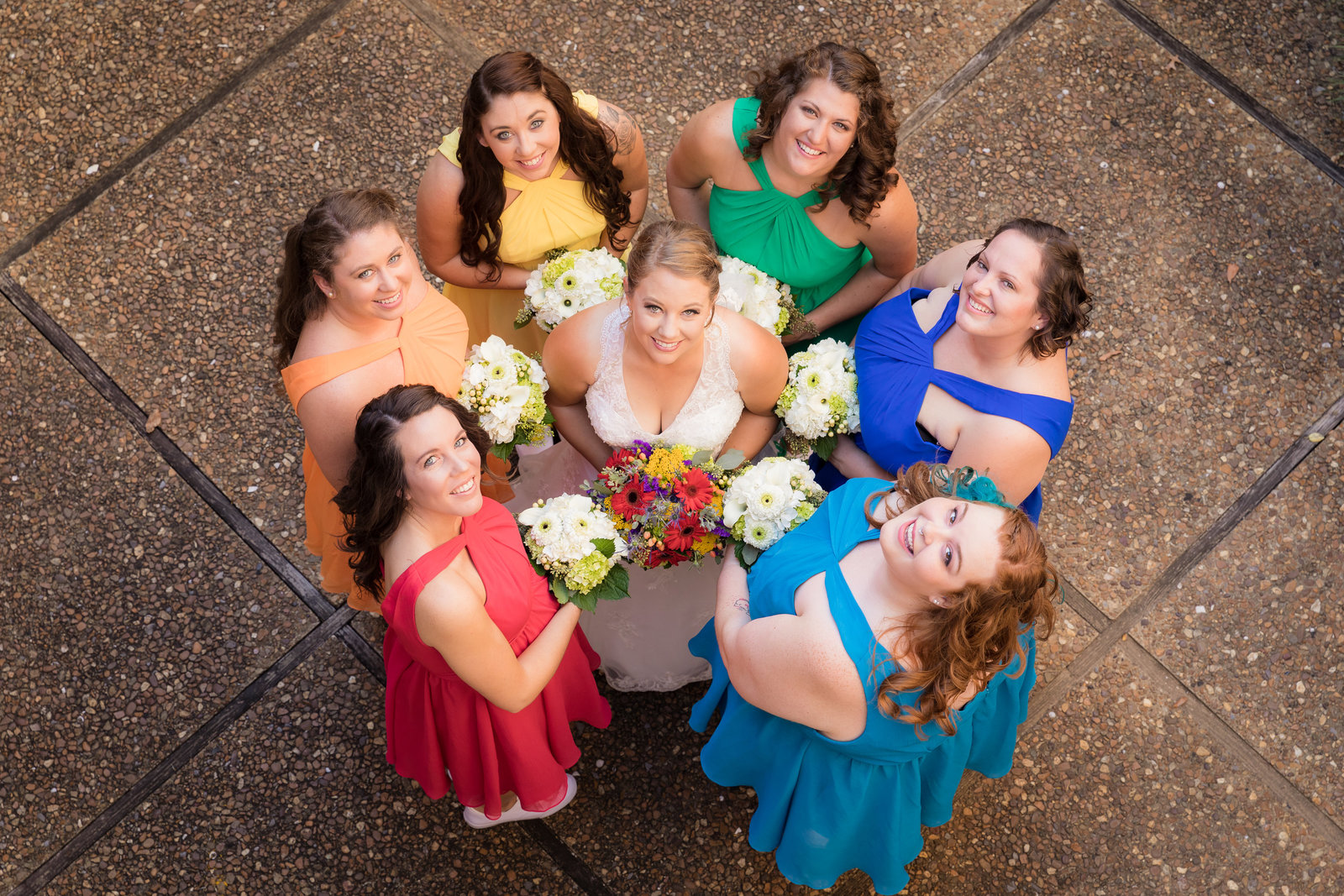 Bright and colorful portrait of a bride with her bridesmaids